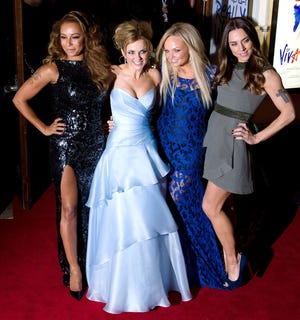 """Members of the British pop girl group Spice Girls (From L-R) Melanie Brown, Geri Halliwell, Emma Bunton and Melanie Chisholm pose for pictures as they arrive for the premiere of the Spice Girls musical """"Viva Forever"""" in central London on Dec. 11, 2012."""