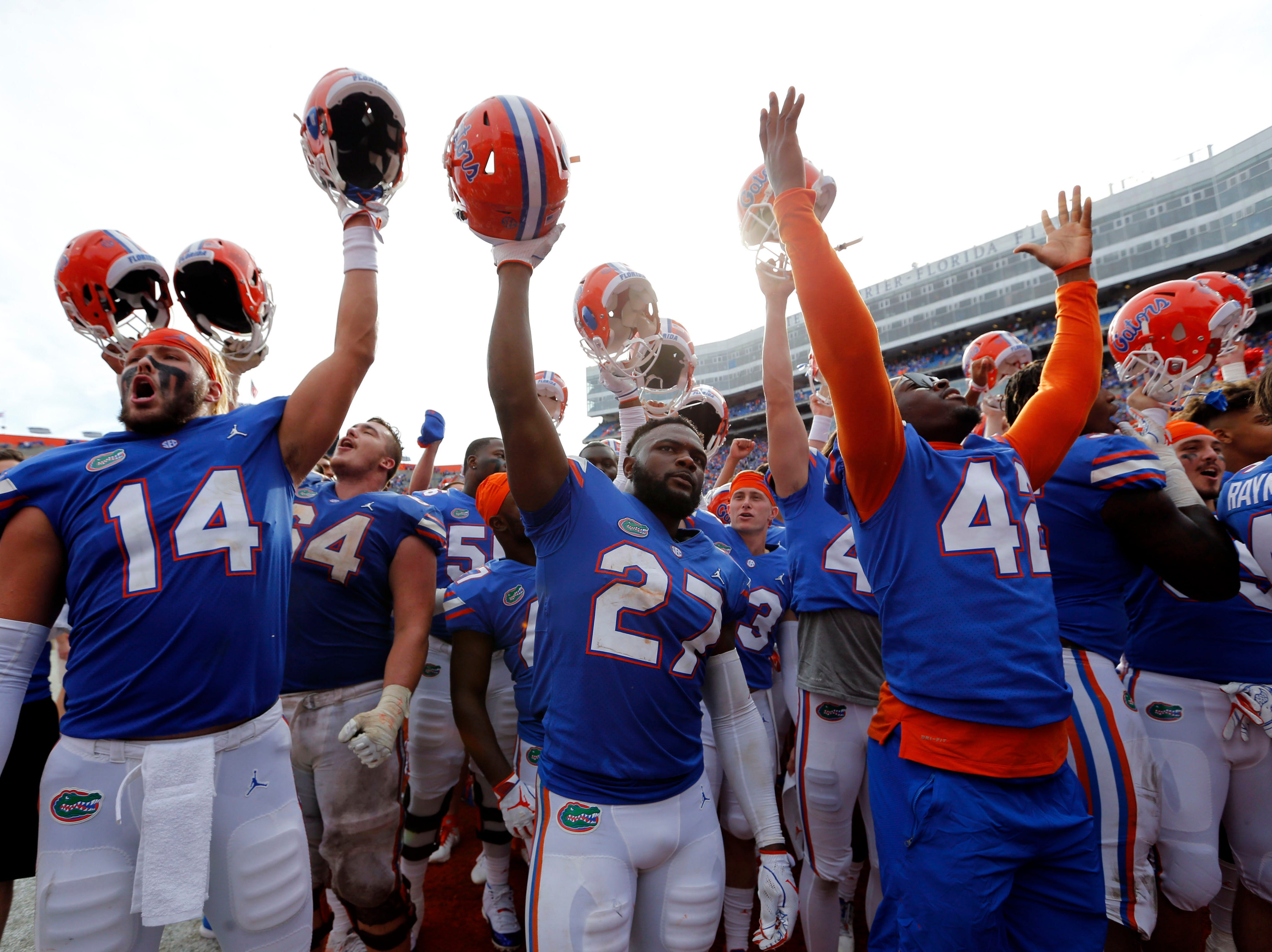 Florida Gators tight end Lucas Krull (14), running back Dameon Pierce (27) and teammates celebrate as they beat the South Carolina Gamecocks at Ben Hill Griffin Stadium.