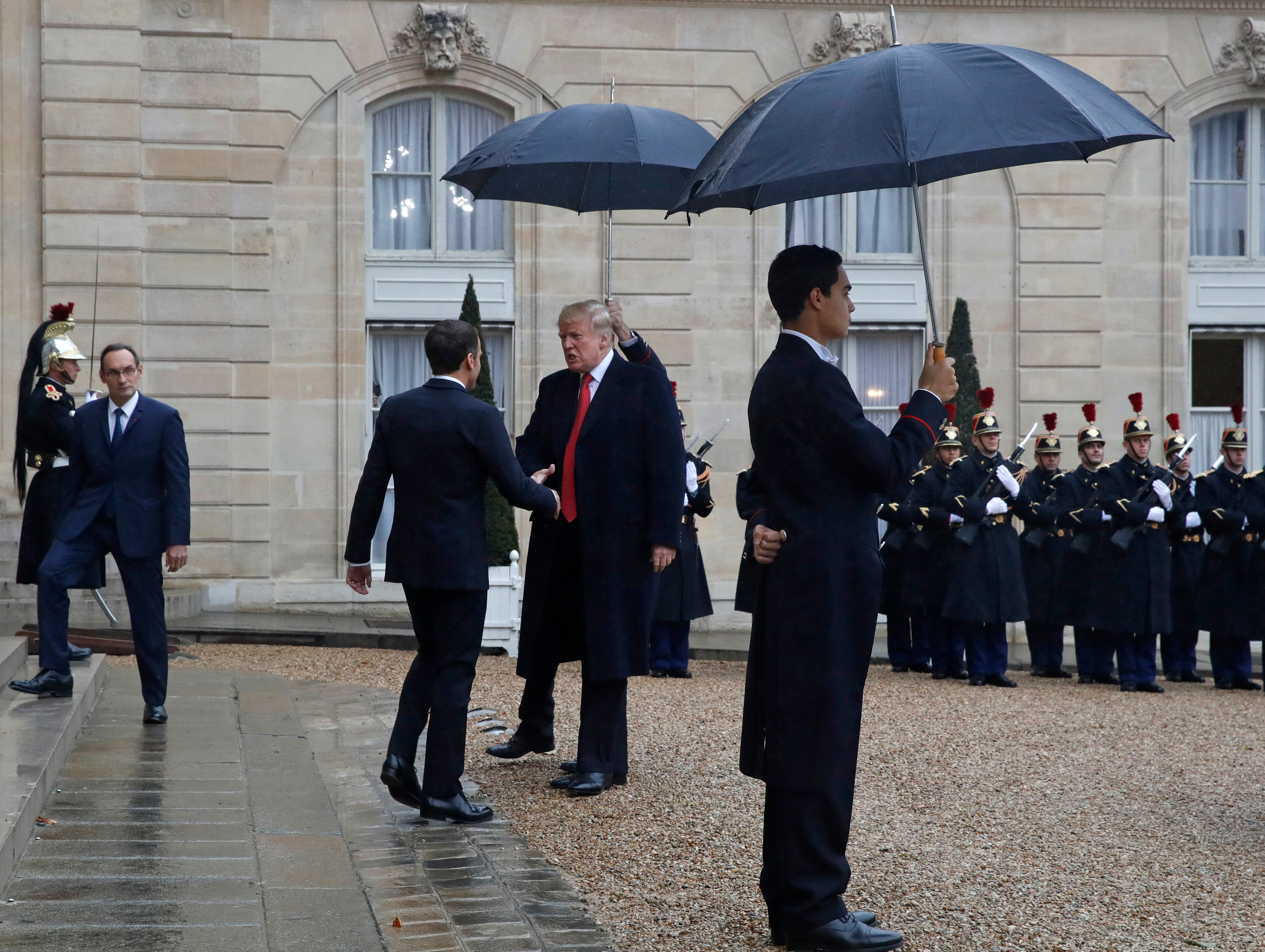 President Donald Trump is greeted by French President Emmanuel Macron after arriving at the Elysee Palace in Paris, Saturday Nov. 10, 2018. Trump is joining other world leaders at centennial commemorations in Paris this weekend to mark the end of World War I.