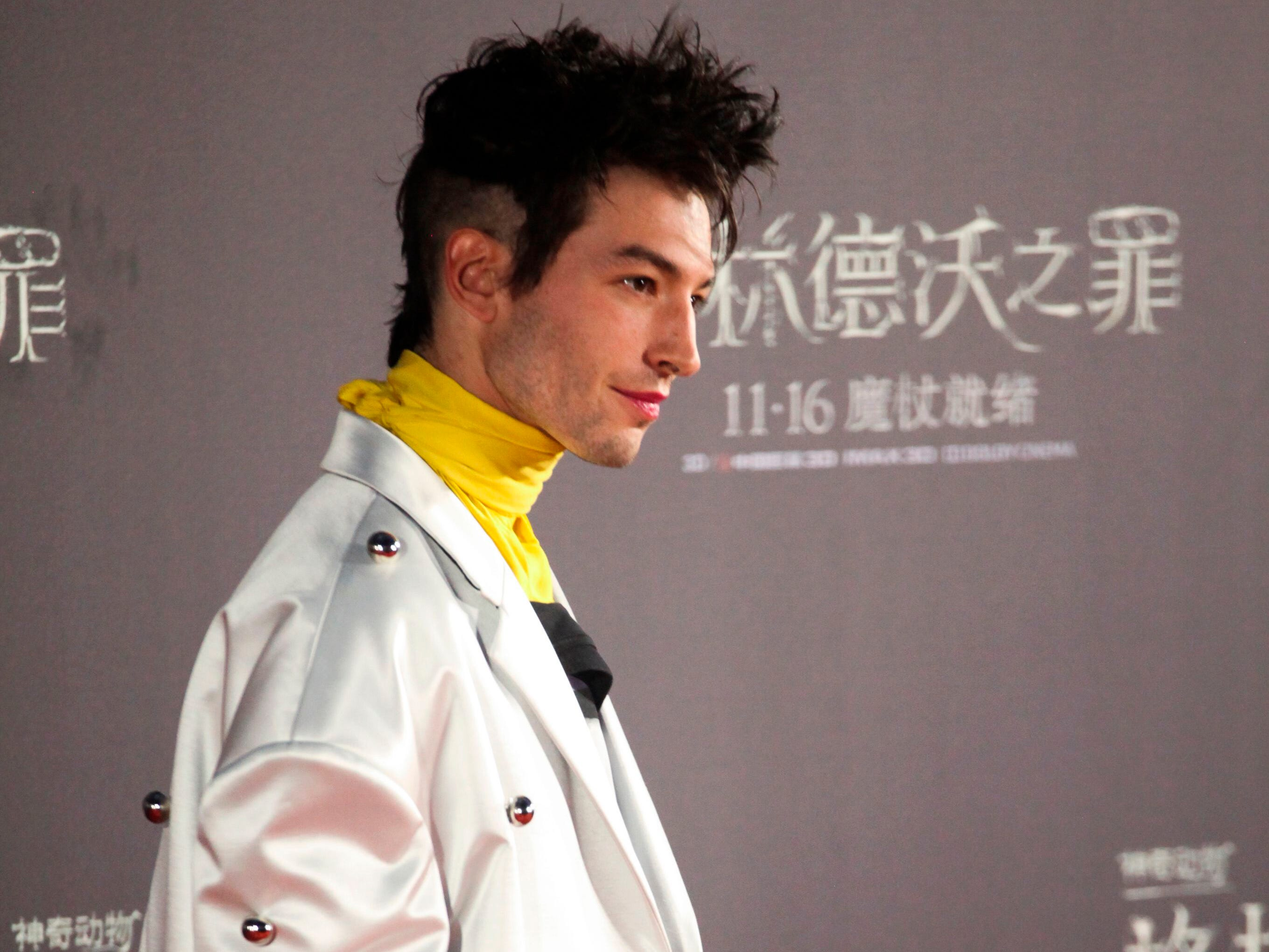 Actor Ezra Miller poses for a photo on the red carpet during a promotional event of the movie 'Fantastic Beasts: The Crimes of Grindelwald' in Beijing on October 28, 2018. (Photo by LEO RAMIREZ / AFP)LEO RAMIREZ/AFP/Getty Images ORIG FILE ID: AFP_1AD9ZZ