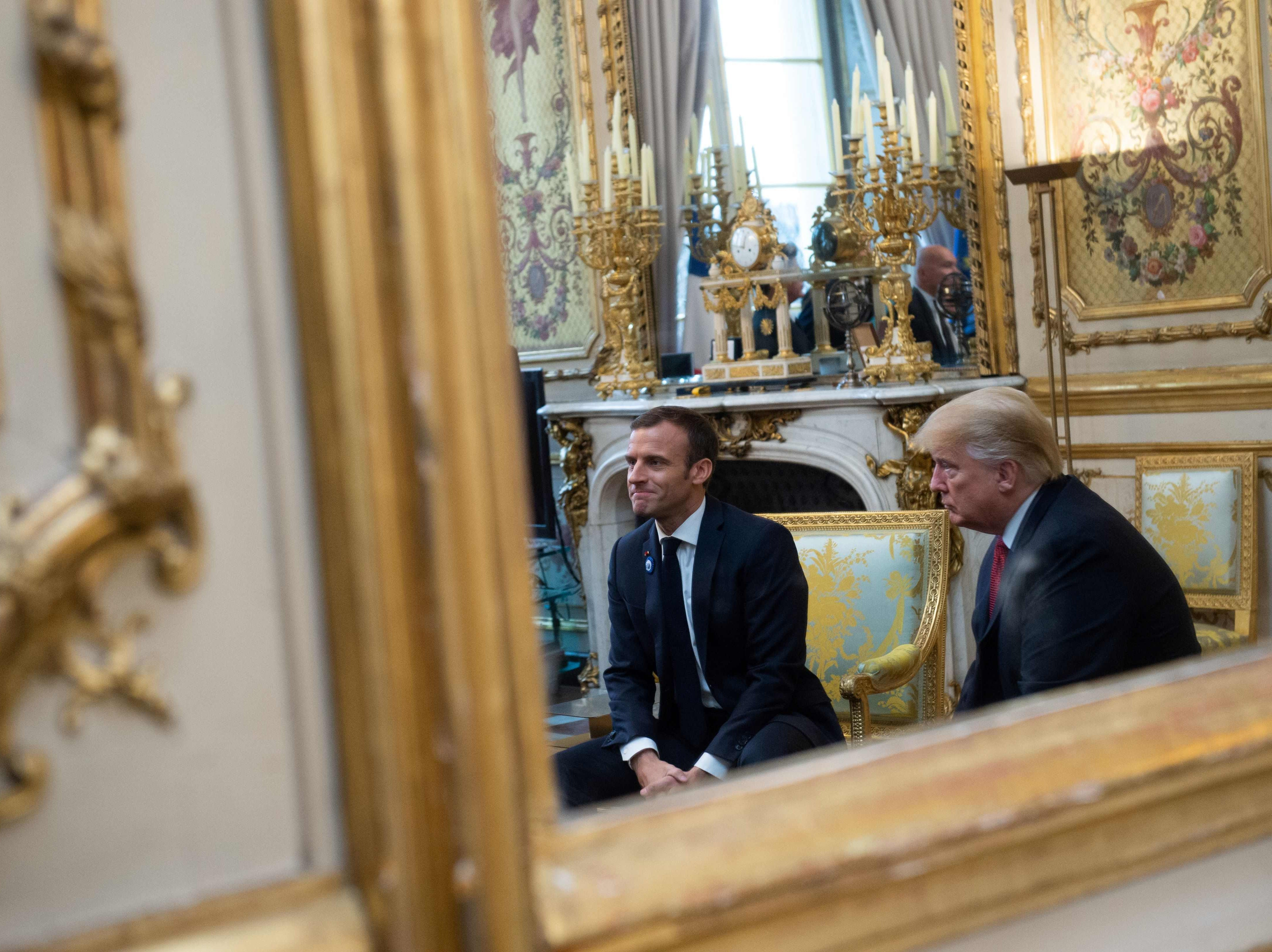 President Donald Trump speaks with French president Emmanuel Macron prior to their meeting at the Elysee Palace in Paris, on Nov. 10, 2018, on the sidelines of commemorations marking the 100th anniversary of the 11 November 1918 armistice, ending World War I.