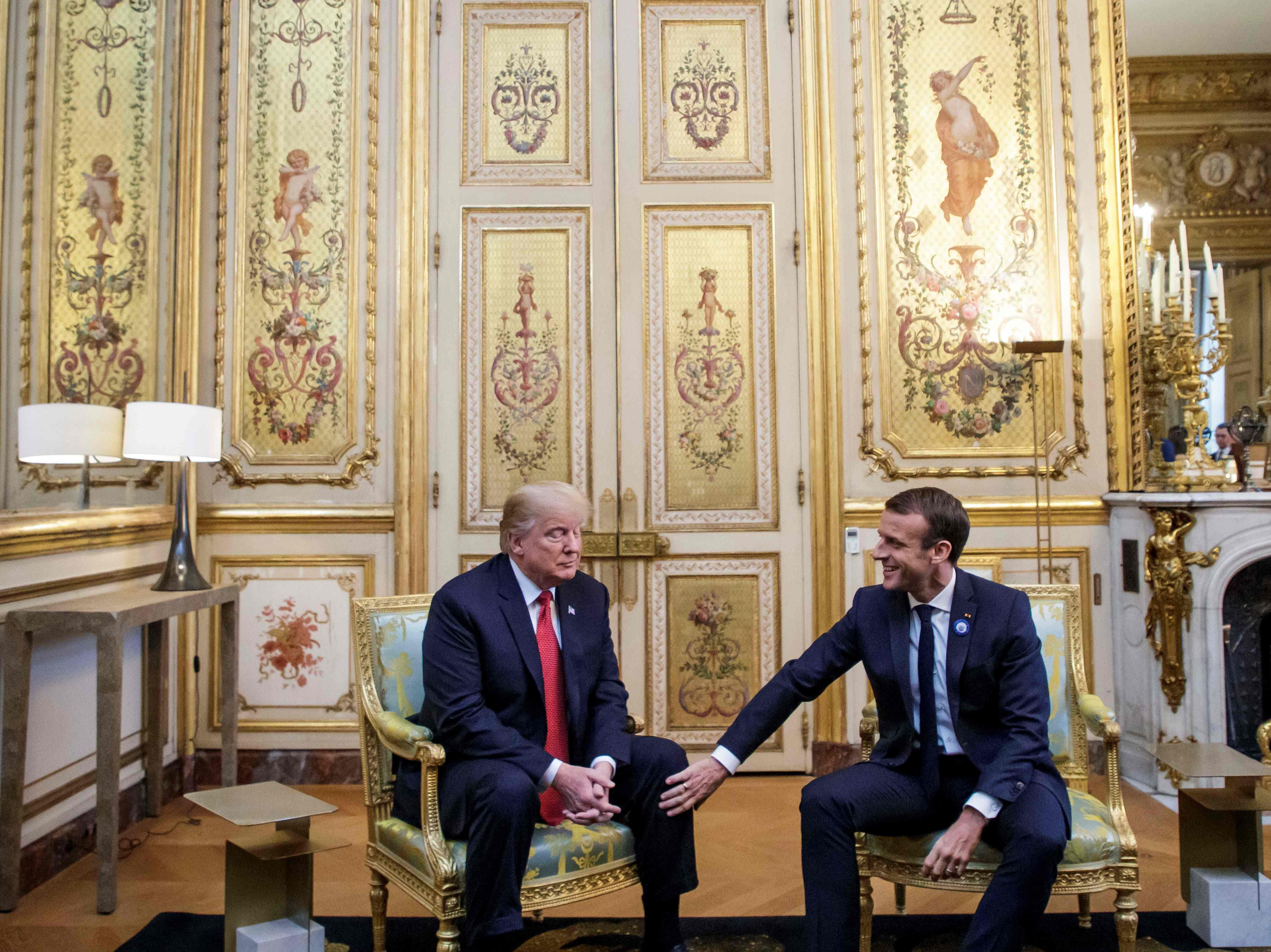 President Donald Trump speaks with French president Emmanuel Macron prior to their meeting at the Elysee Palace in Paris on Nov. 10, 2018, on the sidelines of commemorations marking the 100th anniversary of the November 11, 1918 armistice, ending World War I.