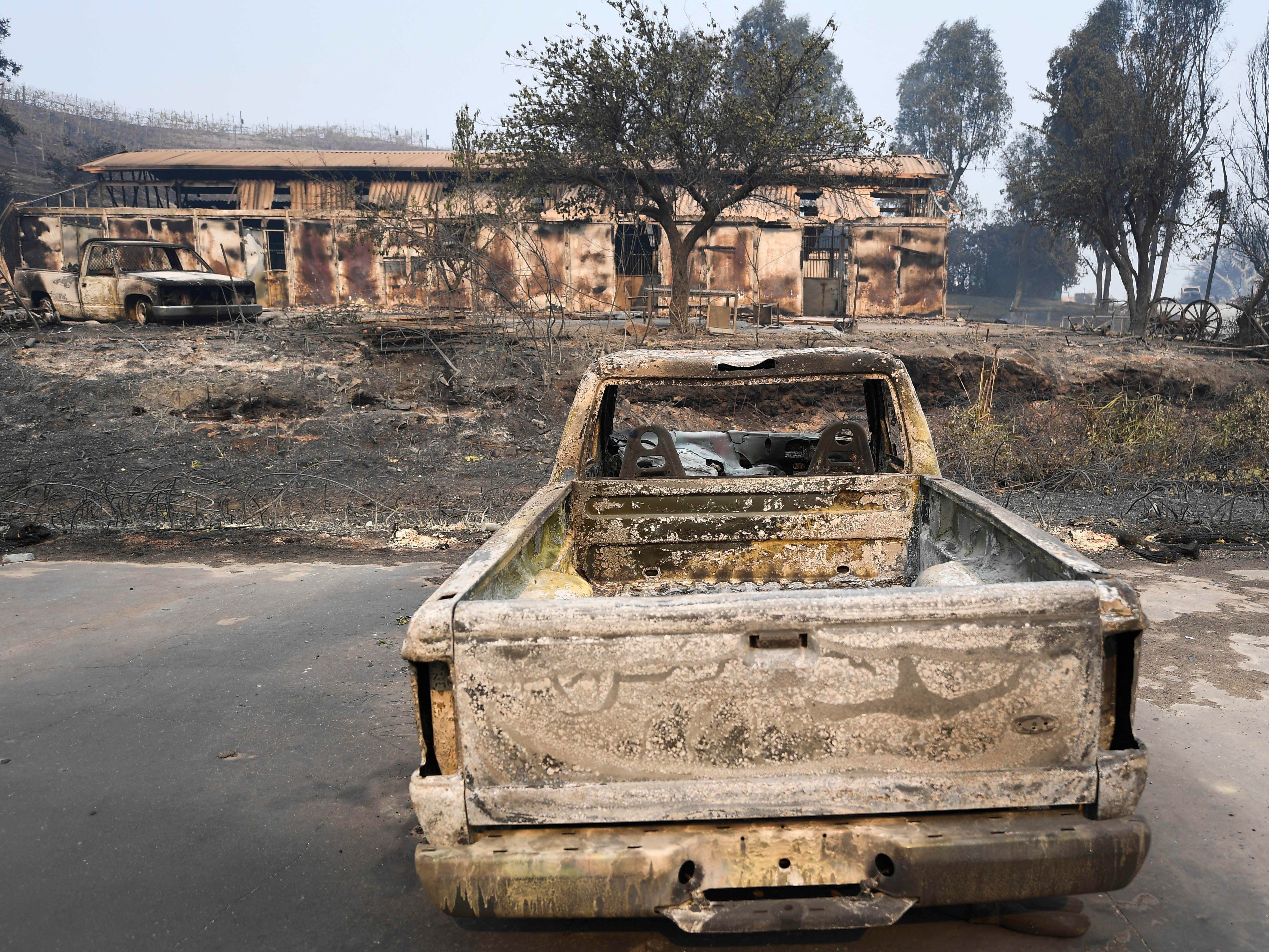 Burned out trucks and a building on the Saddlerock Ranch property in Malibu, Calif, in the aftermath of the Woosley Fire that as of Nov 10, 2018, reportedly consumed 70,000 acres.