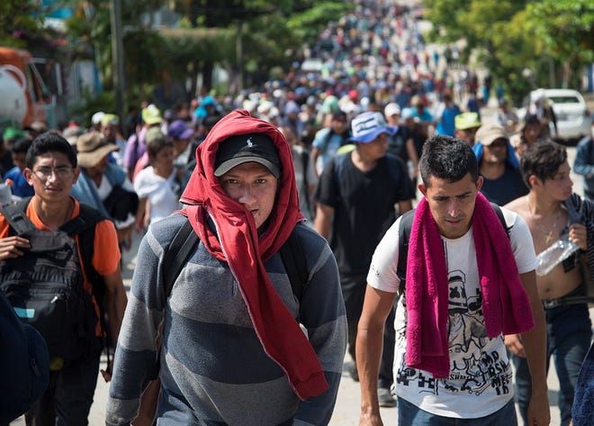 epa07154569 Members of the third migrant caravan, from El Salvador, arrive at the municipality of Matías Romero, in the state of Oaxaca, Mexico, 09 November 2018. A third caravan originating in El Salvador left the southern state of Chiapas today to enter Oaxaca and follow the same route as the previous contingents. After failing to get the UN to provide them with free transportation, the thousands of migrants from the caravan of Central Americans camped in Mexico City today agreed to prepare to leave the capital on Saturday and resume their march on foot to the United States.  EPA-EFE/Lusi Villalobos ORG XMIT: AME1571
