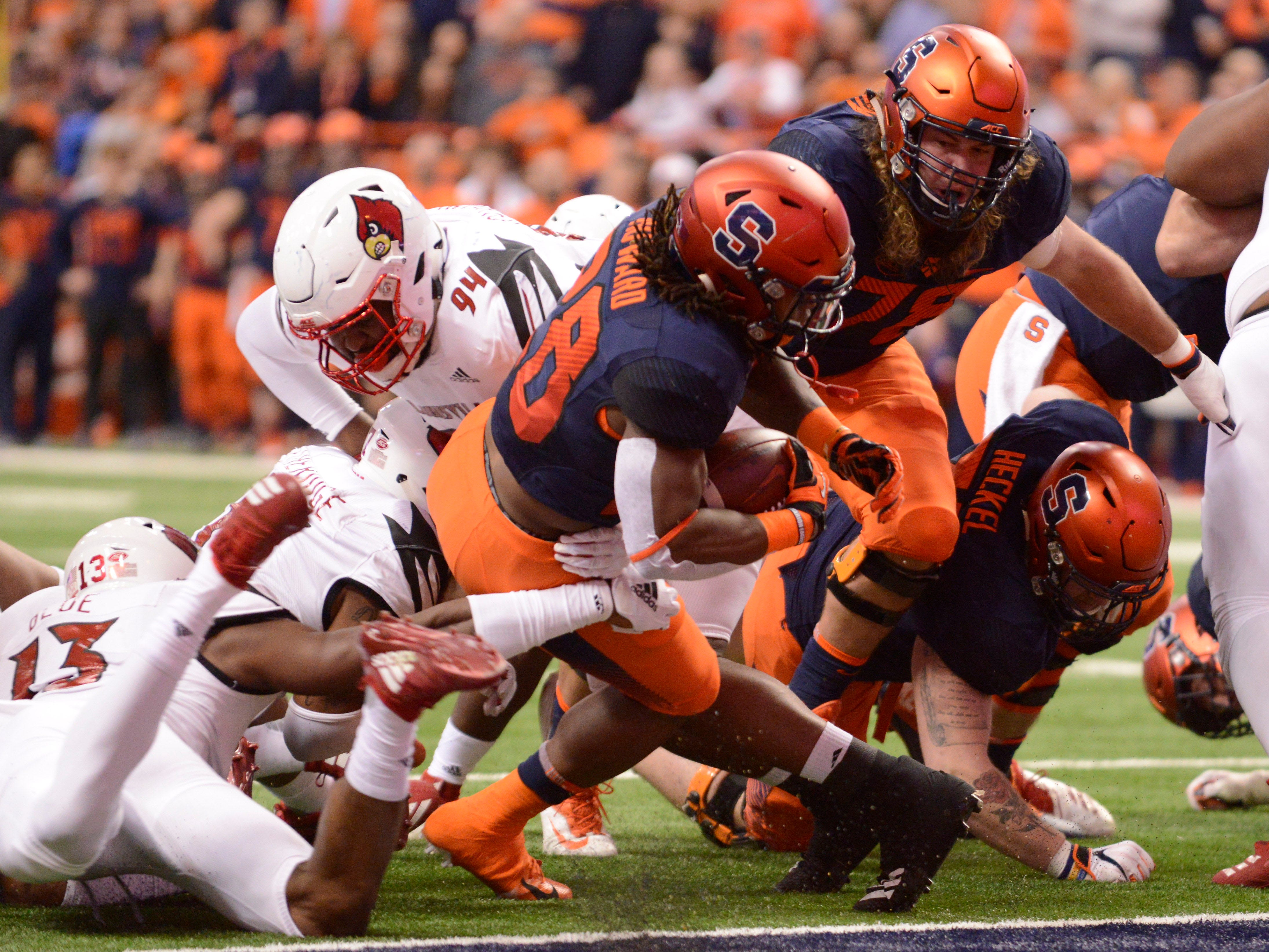 Syracuse Orange running back Jarveon Howard (28) scores a touchdown against the Louisville Cardinals during the first quarter at the Carrier Dome.