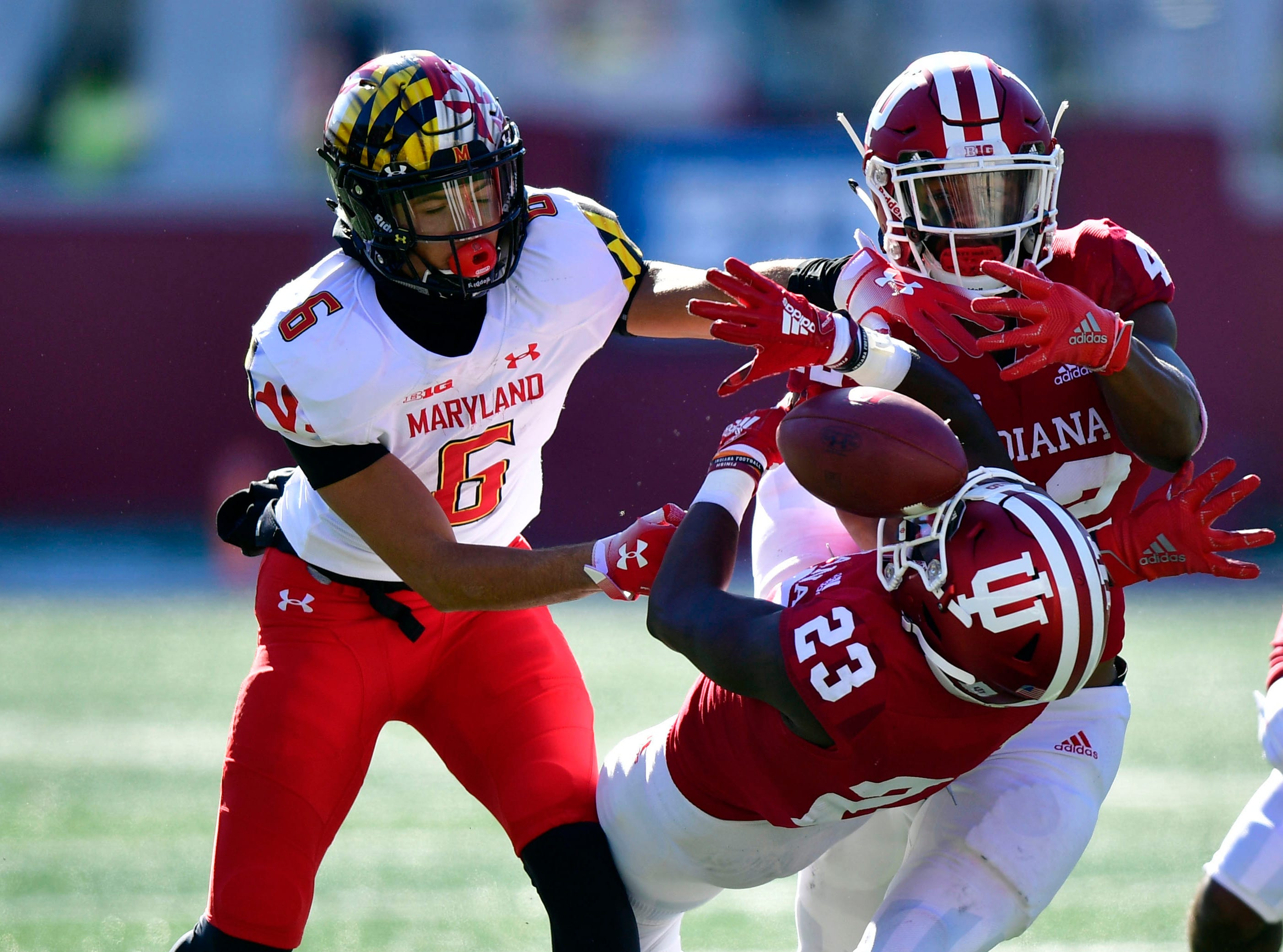 Indiana Hoosiers defensive backs Jaylin Williams (23) and Marcelino Ball (42) attempt to intercept a ball intended for Maryland Terrapins WR Jeshaun Jones during the fist half of the the game at Memorial Stadium.