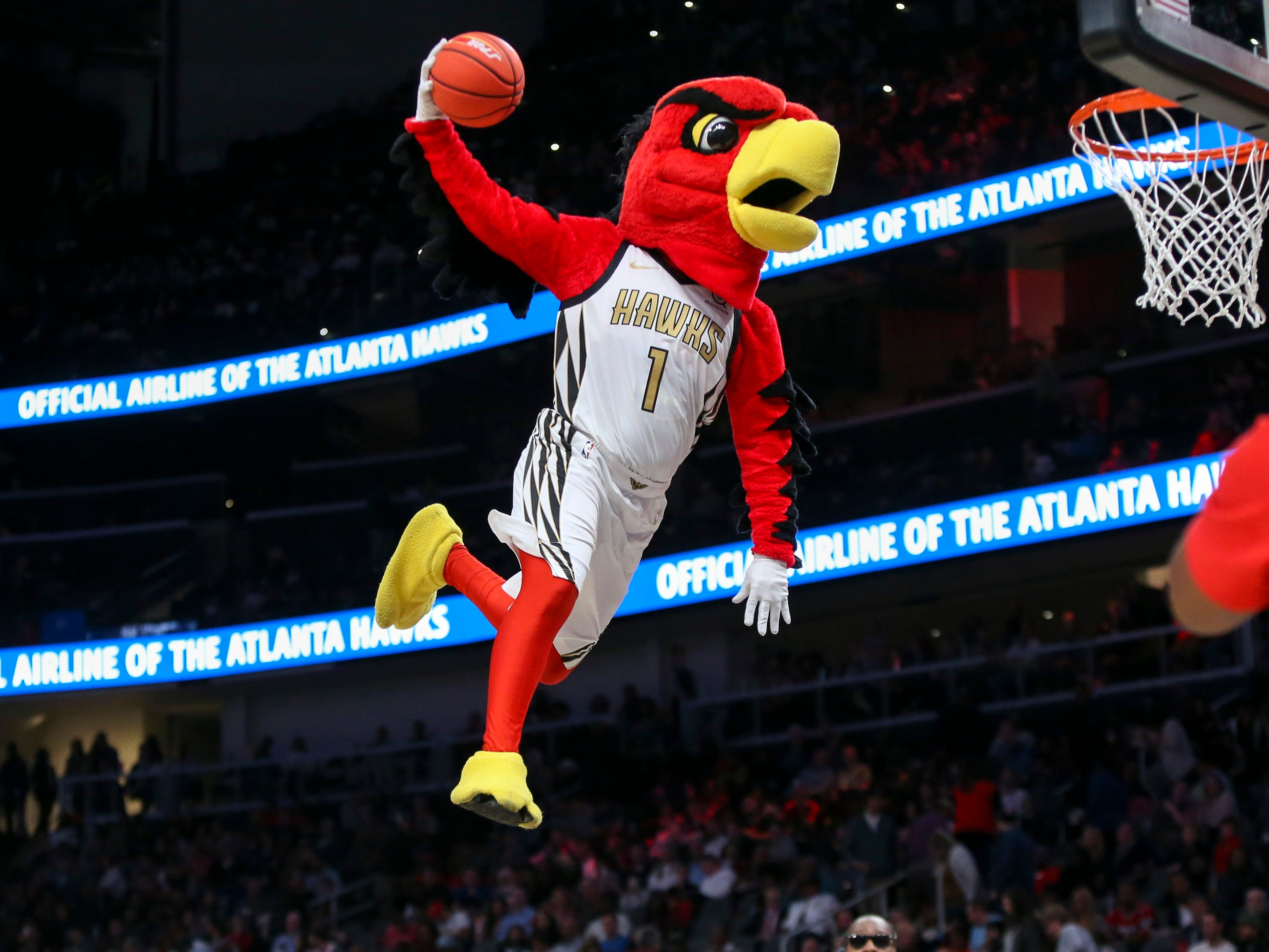 Nov. 9: Atlanta mascot Harry the Hawk entertains the crowd with some high-flying acrobatics.