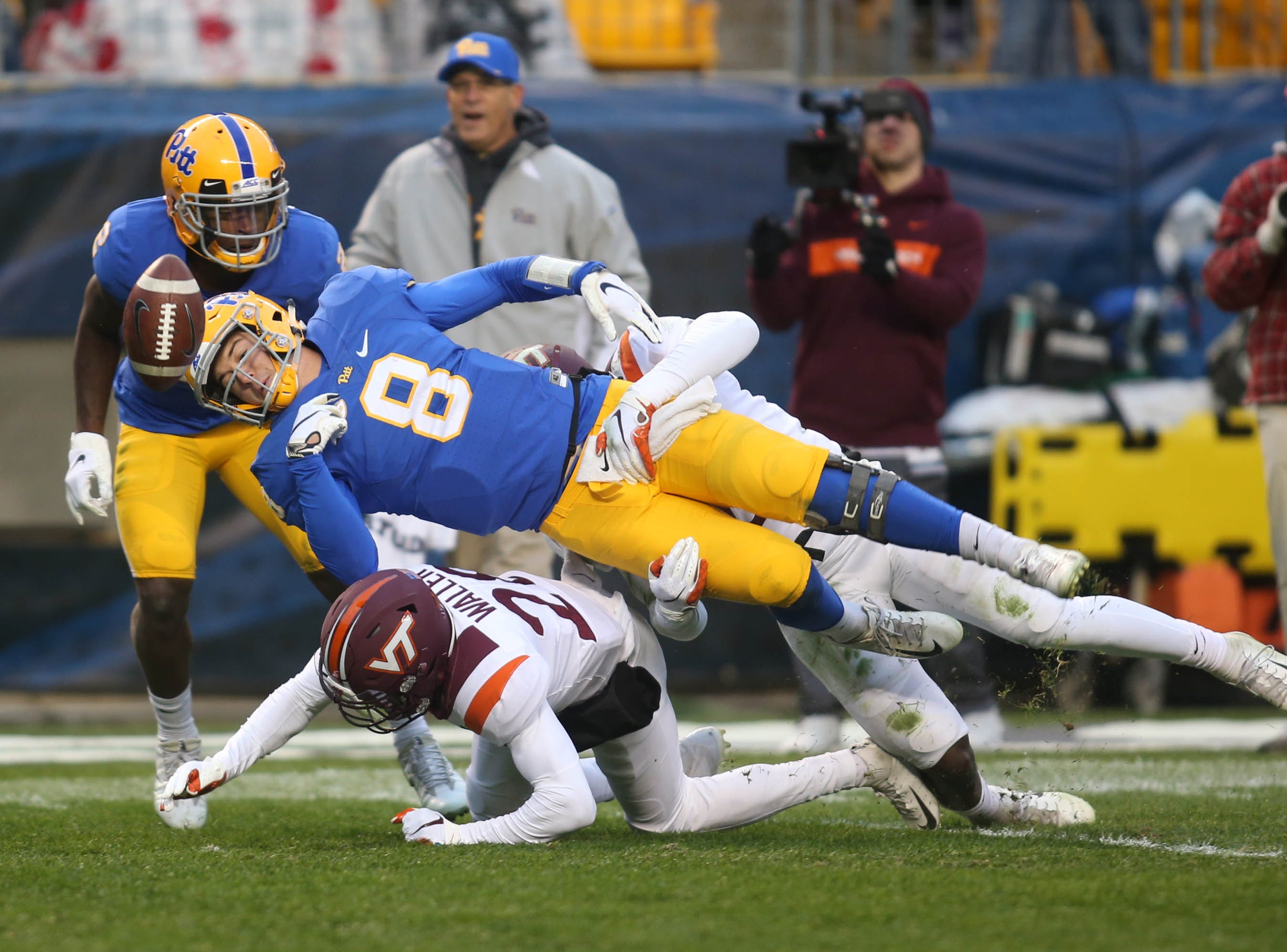 Virginia Tech Hokies defensive back Jermaine Waller (28) causes Pittsburgh Panthers quarterback Kenny Pickett (8) to fumble during the second quarter at Heinz Field.