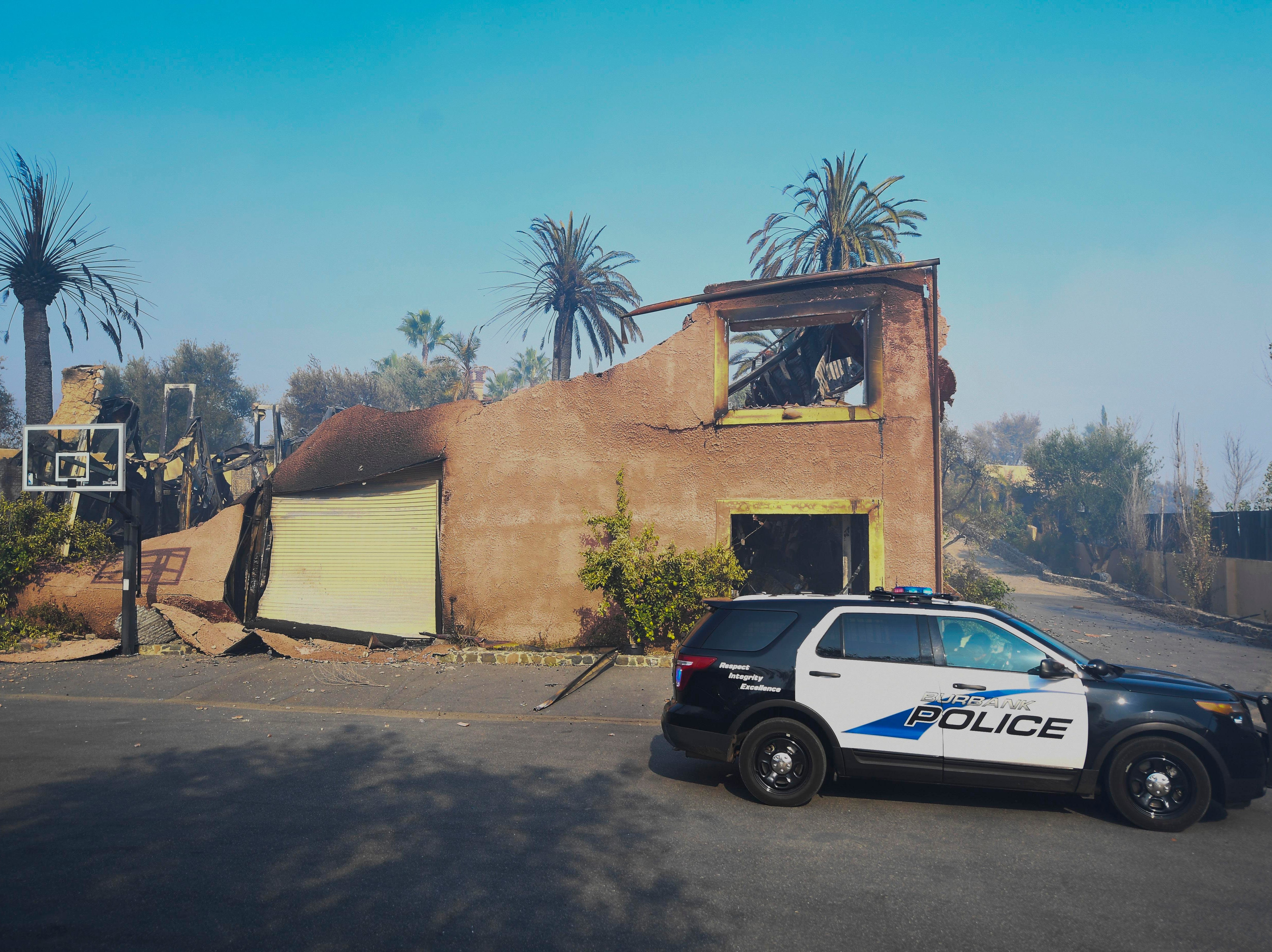"""A police cruiser patrols the neighborhood where the ABC TV series """"The Bachelor"""" is filmed in Beverly Hills, on Nov 10, 2018. The house where series is produced is still standing."""