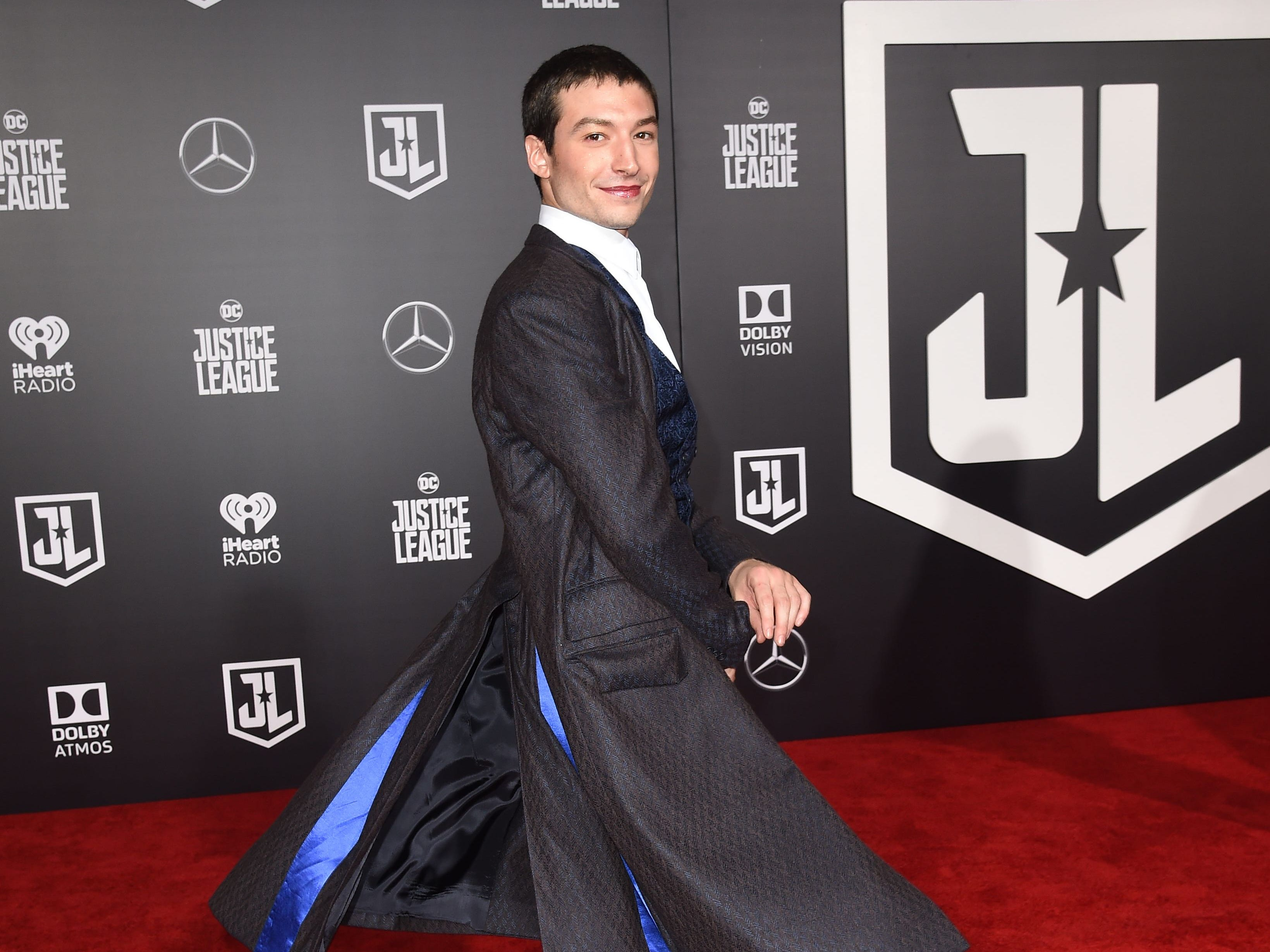 """Actor Ezra Miller arrives for the world premiere of Warner Bros. Pictures' Justice League,"""" November 13, 2017 at the Dolby Theater in Hollywood, California.  / AFP PHOTO / Robyn BeckROBYN BECK/AFP/Getty Images ORG XMIT: Film prem ORIG FILE ID: AFP_U90EZ"""