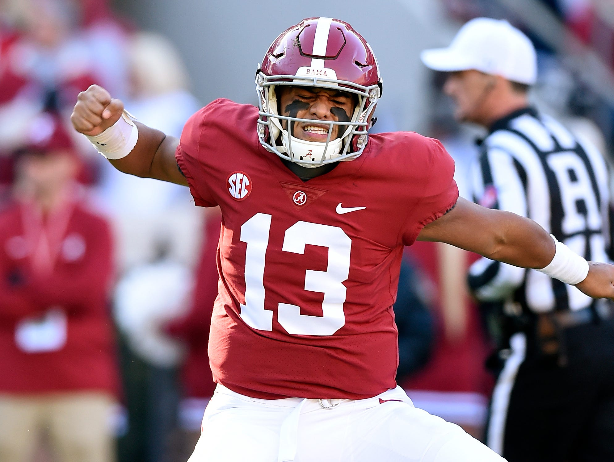 Alabama Crimson Tide quarterback Tua Tagovailoa (13) celebrates a touchdown against the Mississippi State Bulldogs during the first quarter at Bryant-Denny Stadium.