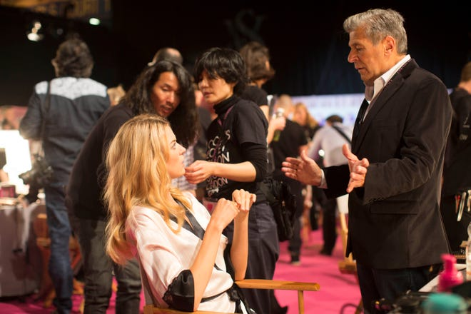 Ed Razek, Victoria's Secret's Chief Marketing Officer, chats with an Angel backstage Dec. 2, 2014, as she's being styled prior to the Victoria's Secret Fashion show.