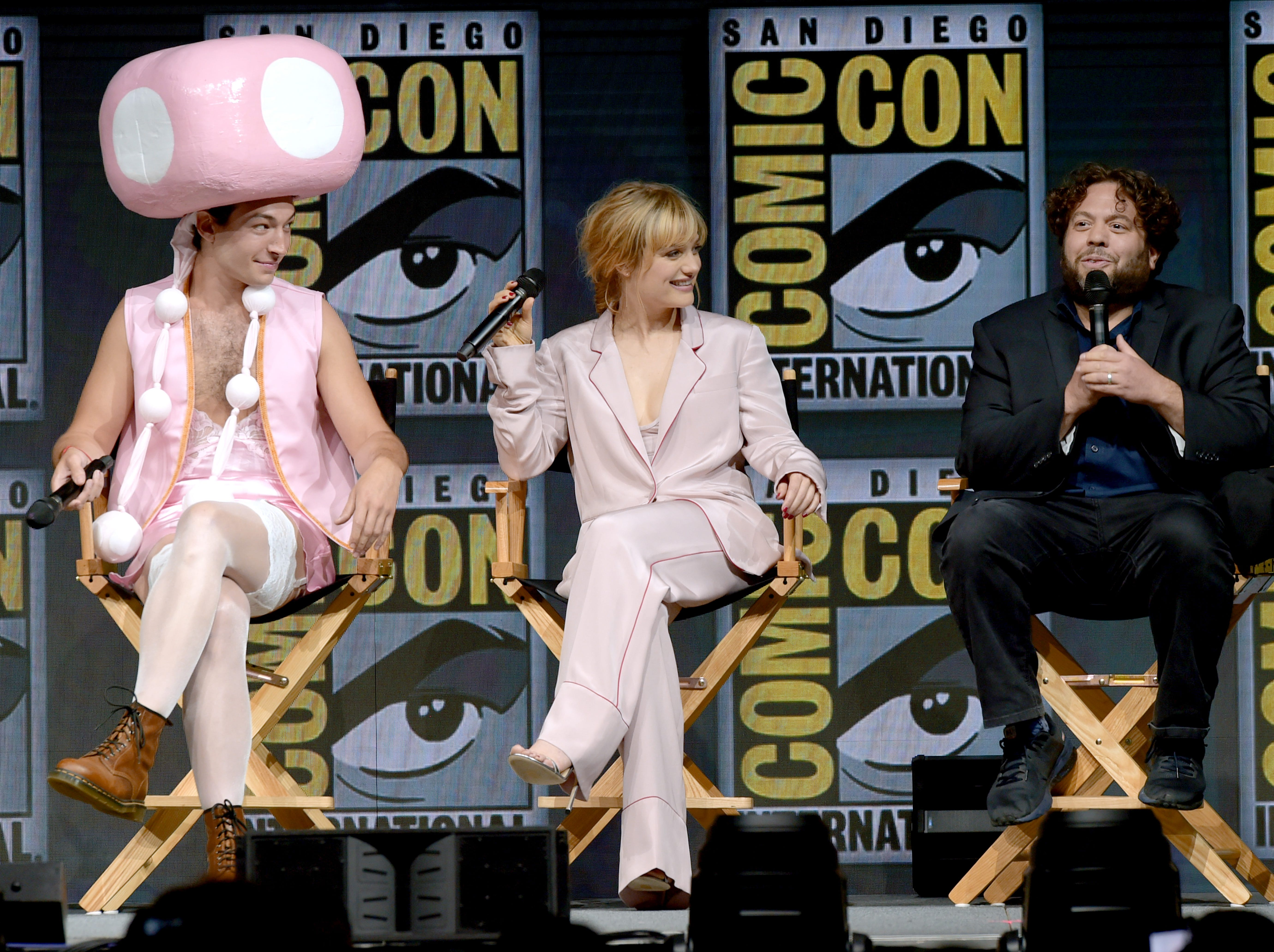 SAN DIEGO, CA - JULY 21:  (L-R) Ezra Miller, Alison Sudol and Dan Fogler speak onstage at the Warner Bros. theatrical panel during Comic-Con International 2018 at San Diego Convention Center on July 21, 2018 in San Diego, California.  (Photo by Kevin Winter/Getty Images) ORG XMIT: 775194454 ORIG FILE ID: 1003297084