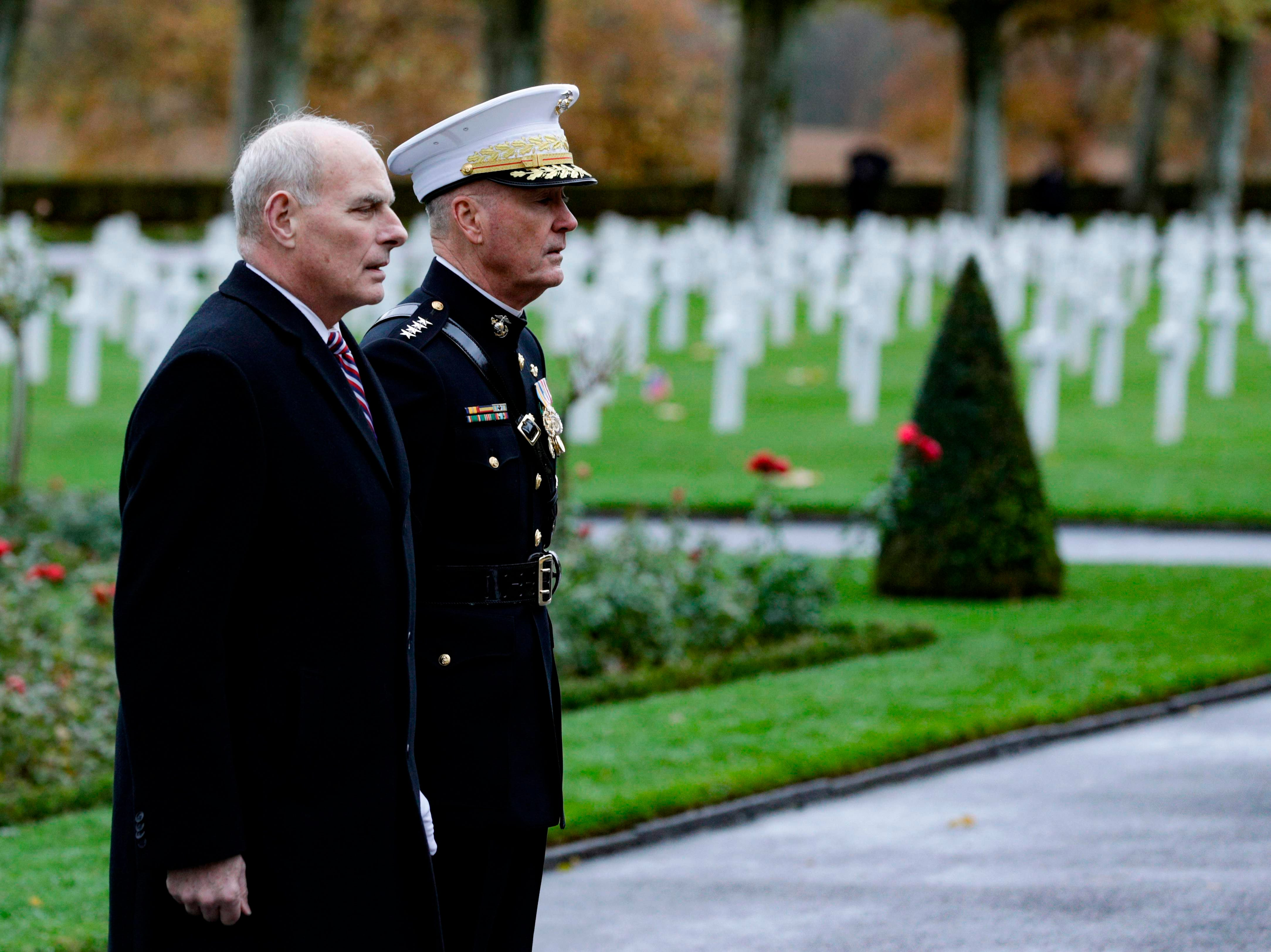 US General Joseph Dunford, right, and retired United States Marine Corps general John F Kelly White House Chief of Staff visit the Aisne-Marne American Cemetery and Memorial in Belleau, on Nov. 10, 2018 as part of commemorations marking the 100th anniversary of the 11 November 1918 armistice, ending World War I.