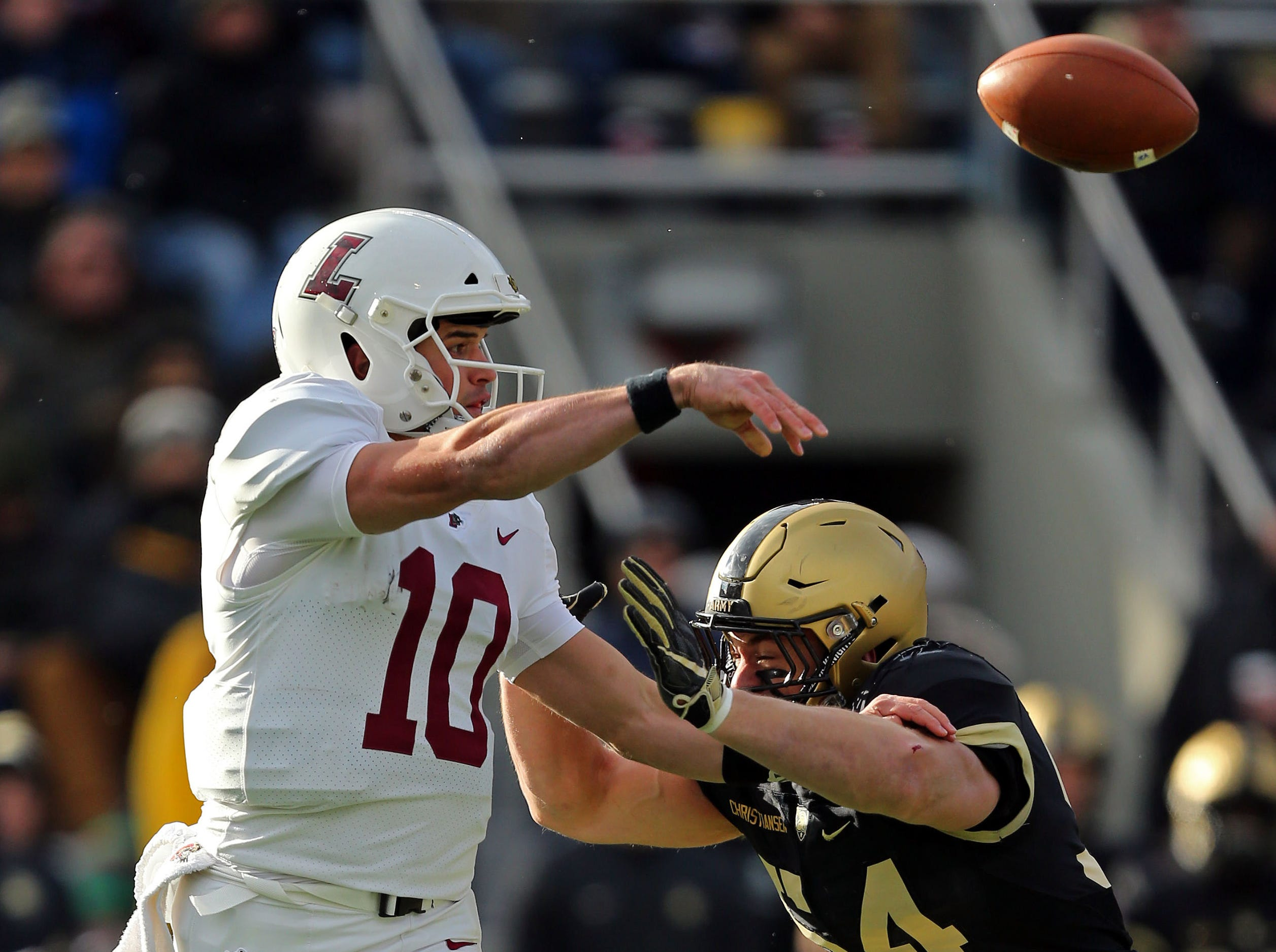 Lafayette Leopards quarterback Sean O'Malley (10) throws a pass over Army Black Knights linebacker Cole Christiansen (54) during the second half at Michie Stadium.