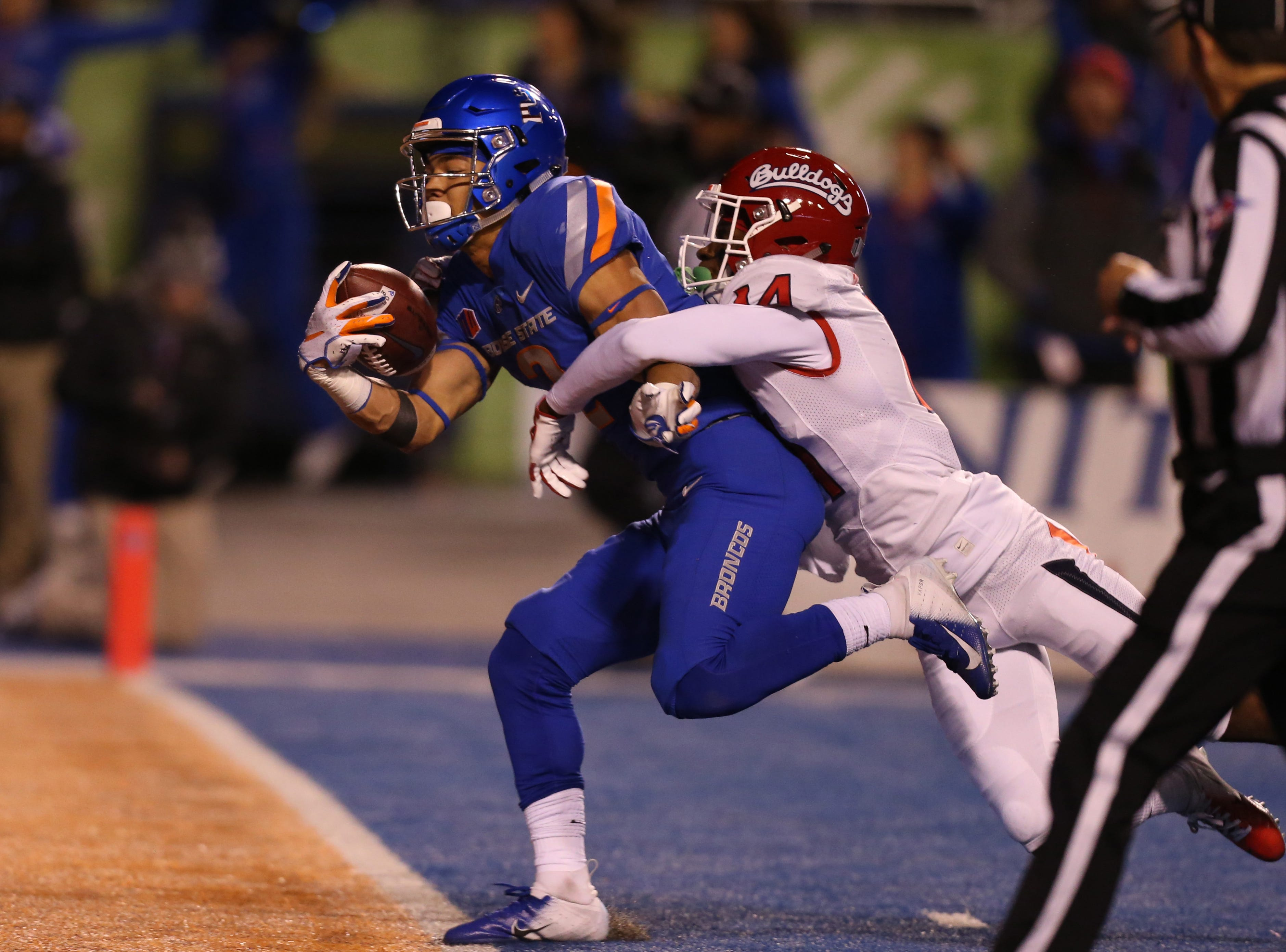 Boise State Broncos wide receiver Khalil Shakir (2) hauls in a 49-yard touchdown pass during the second half of play against the Fresno State Bulldogs at Albertsons Stadium.