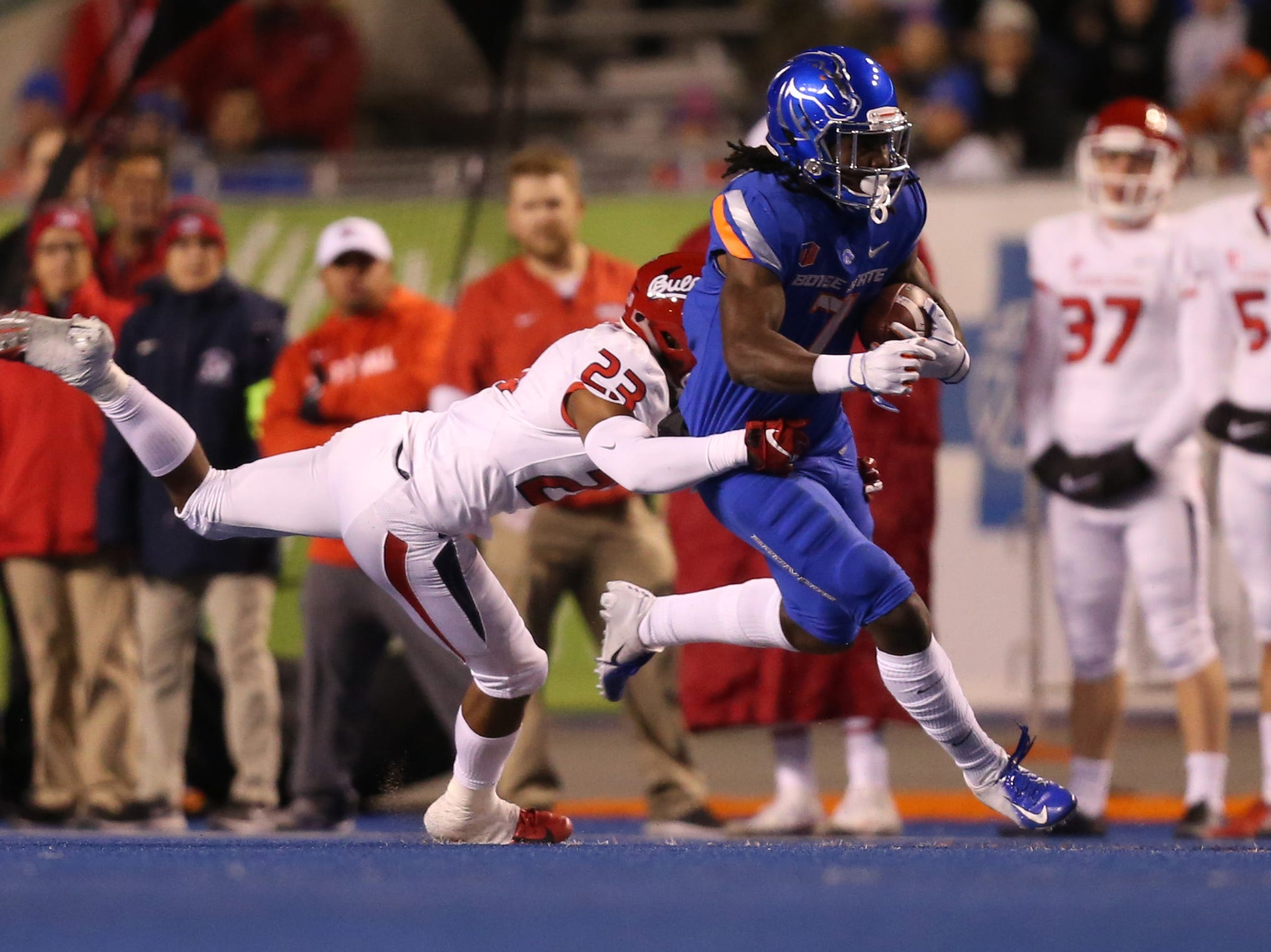 Boise State Broncos wide receiver A.J. Richardson (7) carries the ball as Fresno State Bulldogs defensive back Juju Hughes (23) tackles during the first half at Albertsons Stadium.