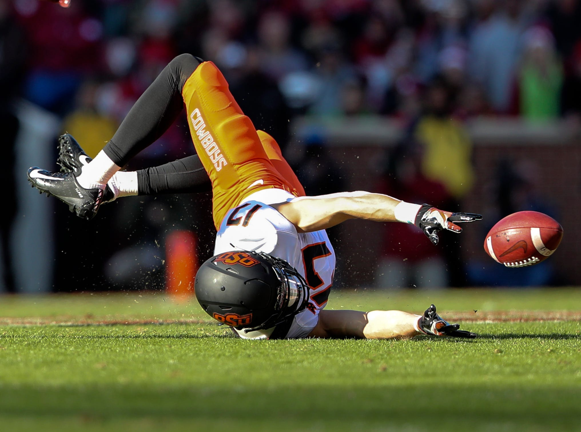 Oklahoma State Cowboys wide receiver Dillon Stoner (17) dives for but cannot make a catch during the first quarter against the Oklahoma Sooners at Gaylord Family-Oklahoma Memorial Stadium.