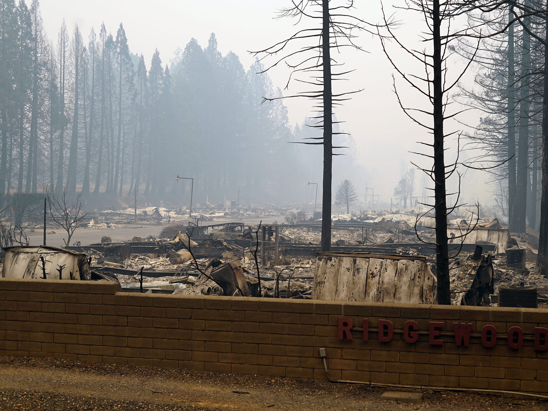 Smoke hangs over the utterly destroyed Ridgewood mobile home park in Paradise, Calif., following the Camp Fire devastation.