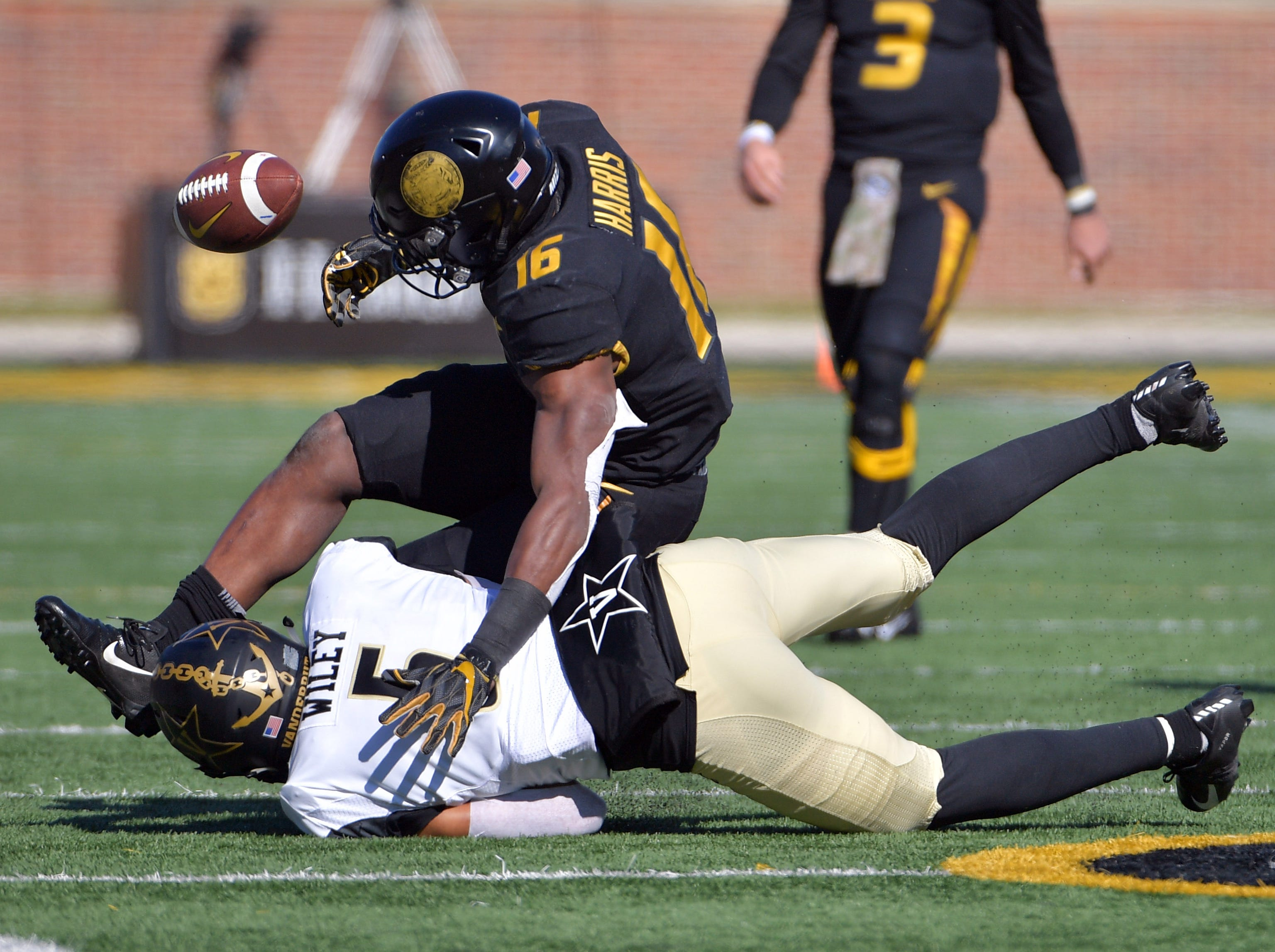 Missouri Tigers running back Damarea Crockett (16) fumbles the ball as he is tackled by Vanderbilt Commodores safety LaDarius Wiley (5) during the first half at Memorial Stadium/Faurot Field.