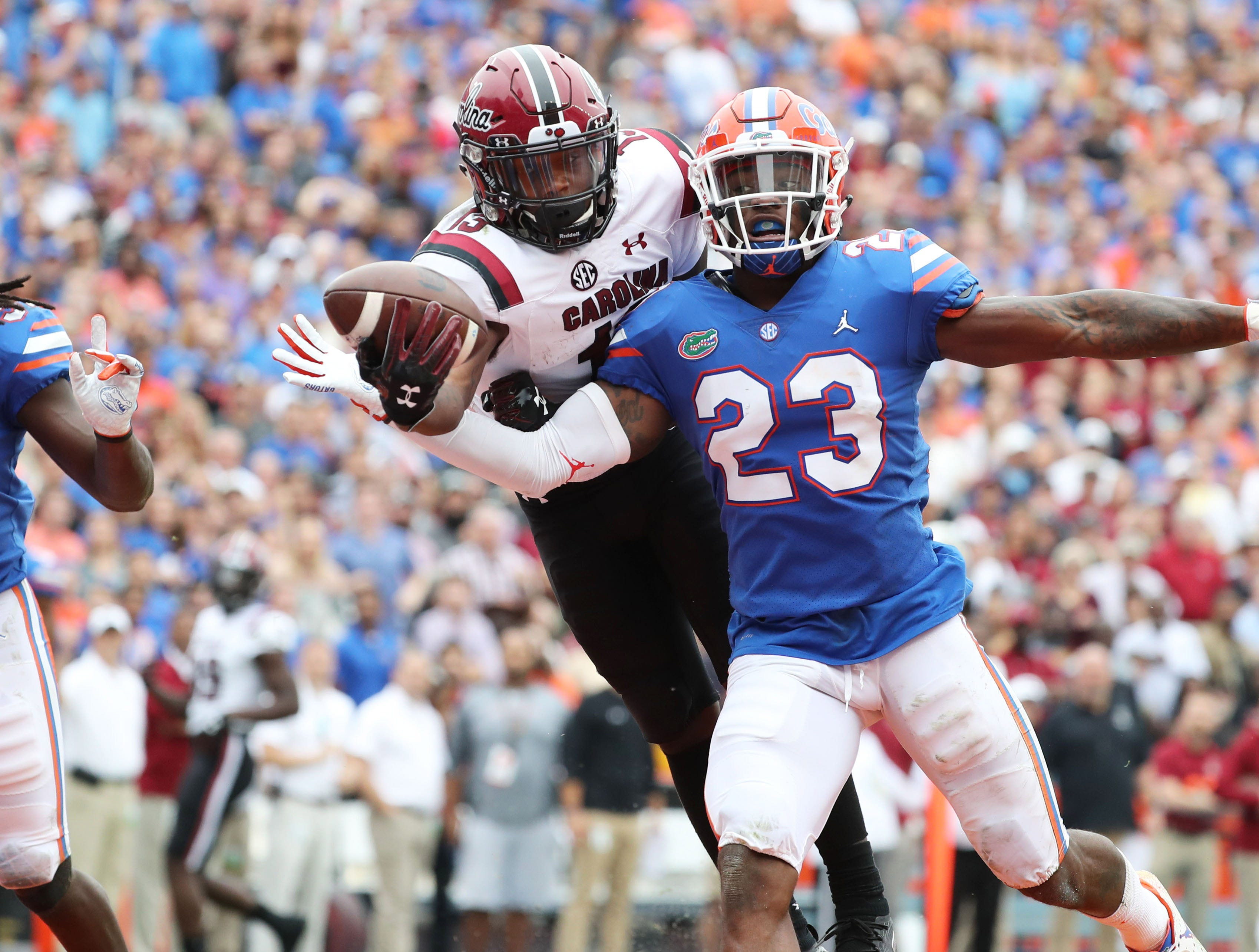 Florida Gators defensive back Chauncey Gardner-Johnson (23) breaks up a pass intended for South Carolina Gamecocks wide receiver Shi Smith (13) during the second quarter at Ben Hill Griffin Stadium.