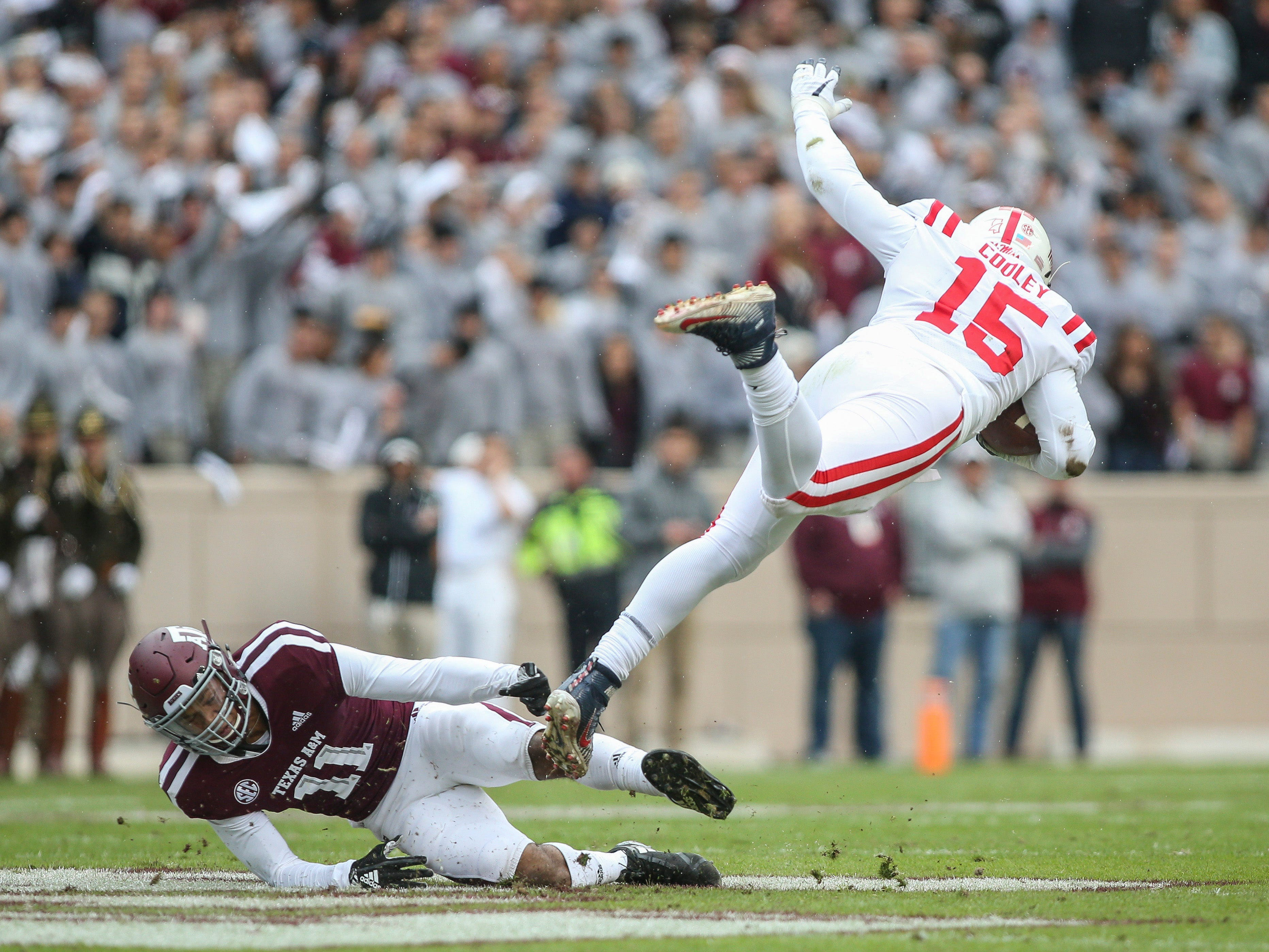 Mississippi Rebels tight end Octavious Cooley (15) leaps to avoid the tackle of Texas A&M Aggies defensive back Larry Pryor (11) after a reception during the first quarter at Kyle Field.