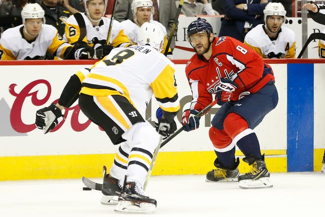 The Washington Capitals and Pittsburgh Penguins played Wednesday night, but what happened in the stands was very poignant.