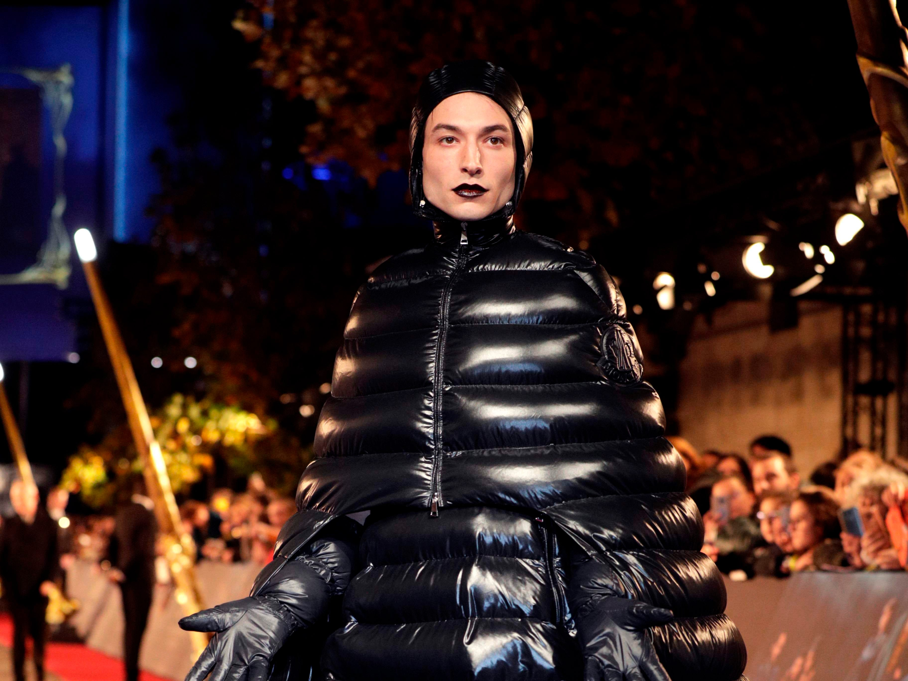 American actor and singer Ezra Miller poses for photographers as he arrives for the premier of the fantasy film 'Fantastic Beasts: The Crimes of Grindelwald' in Paris on November 8, 2018. (Photo by Geoffroy VAN DER HASSELT / AFP)GEOFFROY VAN DER HASSELT/AFP/Getty Images ORIG FILE ID: AFP_1AO87D