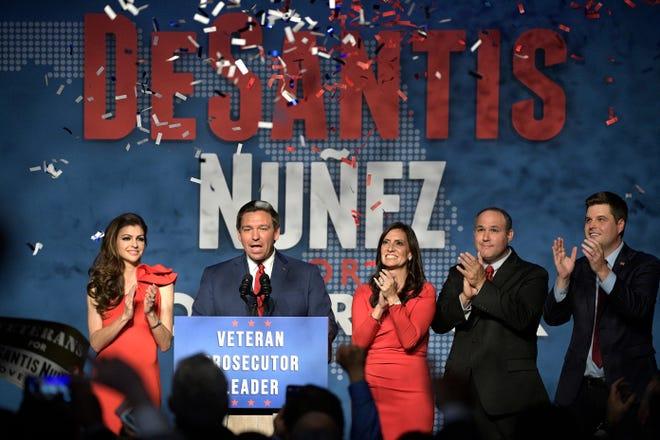 Florida Gov.-elect Ron DeSantis, second from left, thanks supporters with his wife, Casey, left, Lt. Gov.-elect Jeanette Nunez, center; her husband, Adrian Nunez, second from right, and Rep. Matt Gaetz, R-Fla., after being declared the winner of the Florida gubernatorial race at an election party Tuesday, Nov. 6, 2018, in Orlando, Fla.