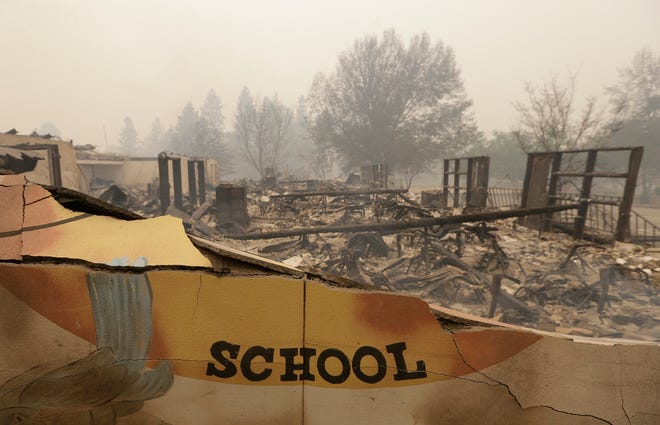 The burned remains of the Paradise Elementary school is seen Friday.  Blocks and blocks of homes and businesses in the Northern California town have been destroyed by a wildfire. Parts of the town of Paradise were still on fire on Friday.