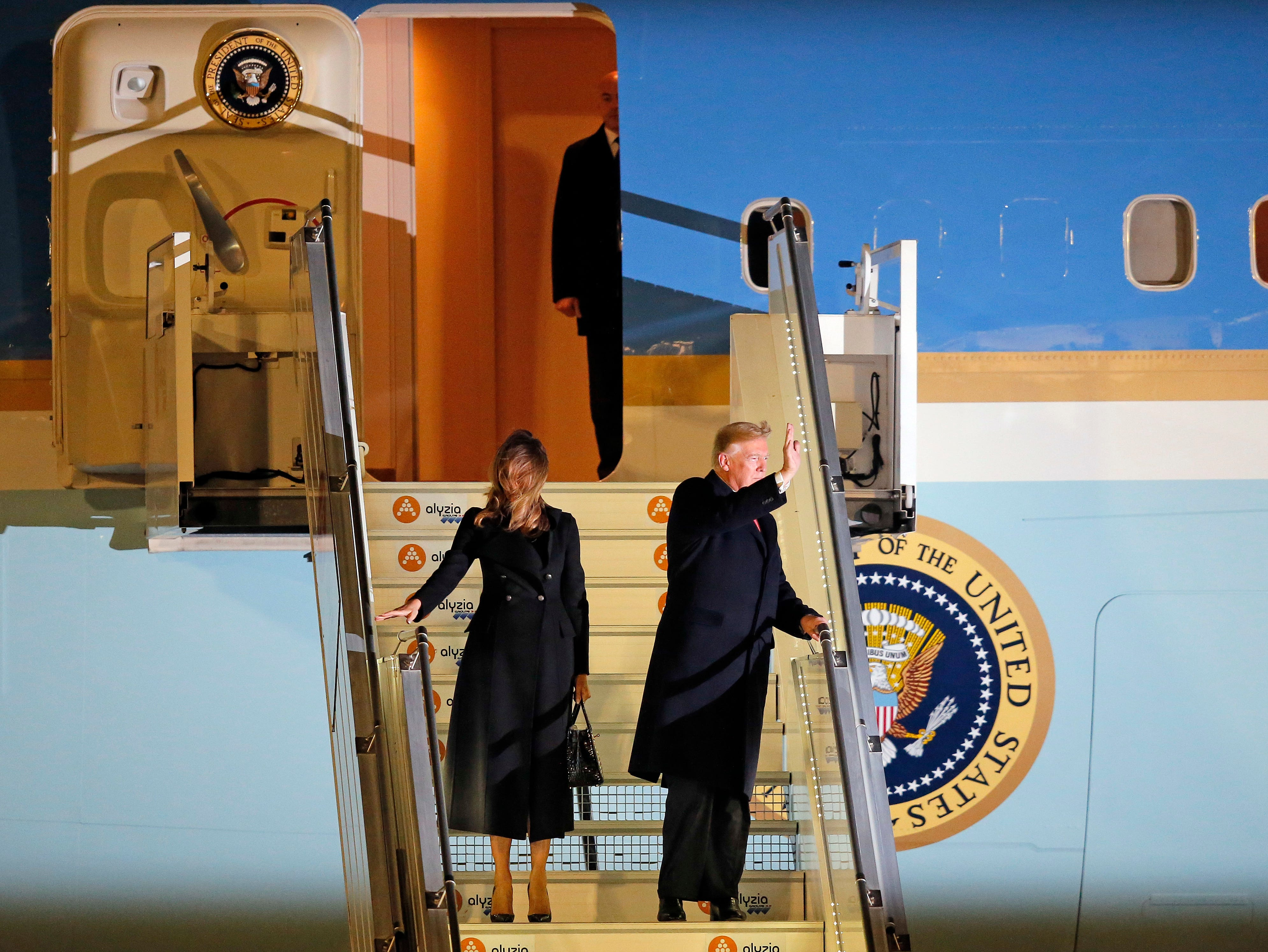 President Donald Trump and first lady Melania Trump alight from Air Force One, after arriving at Orly airport near Paris, Friday, Nov. 9, 2018. Trump is joining other world leaders at centennial commemorations in Paris this weekend to mark the end of World War I.