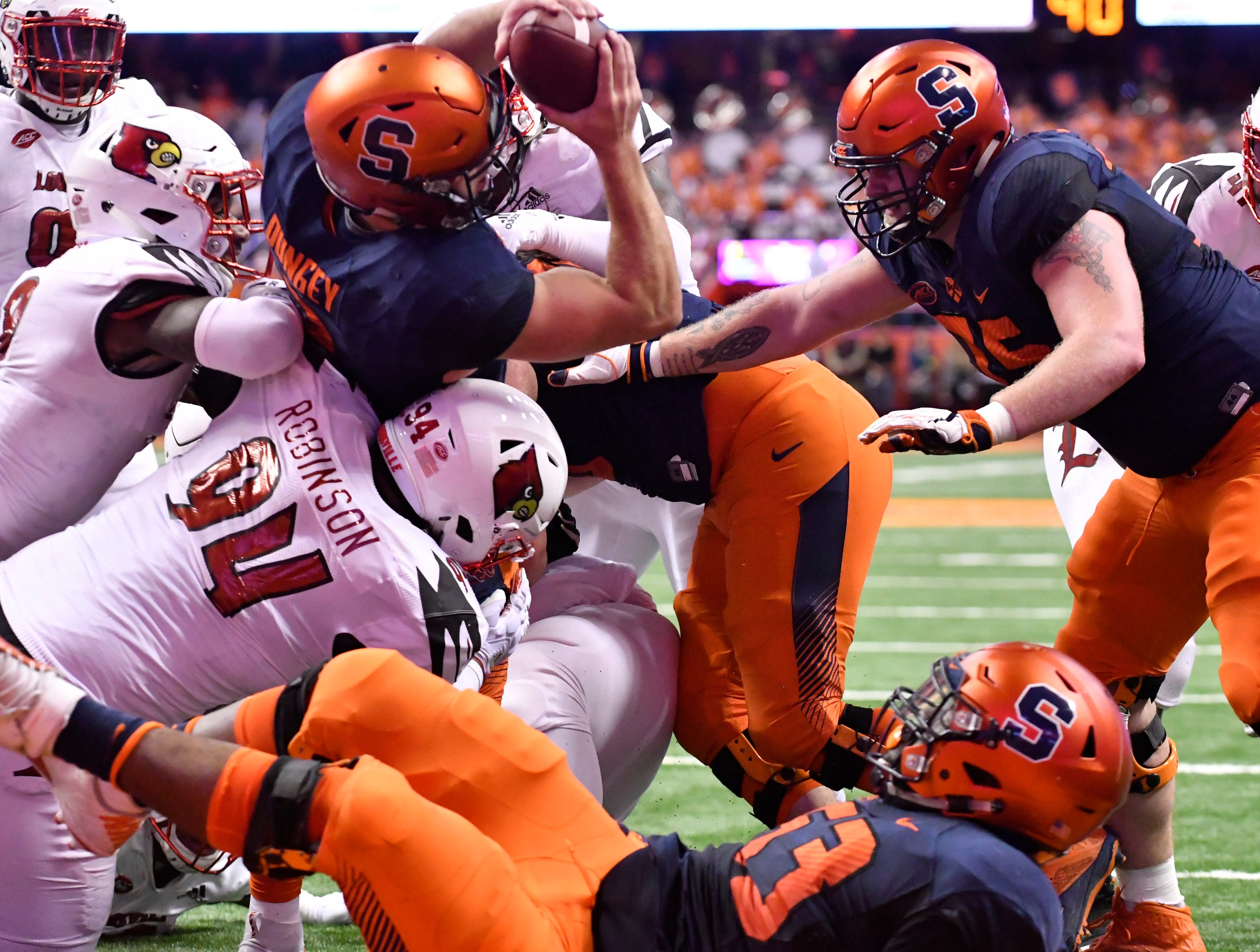 Syracuse Orange quarterback Eric Dungey (2) scores a rushing touchdown over Louisville Cardinals defensive lineman G.G. Robinson (94) during the second quarter at the Carrier Dome.