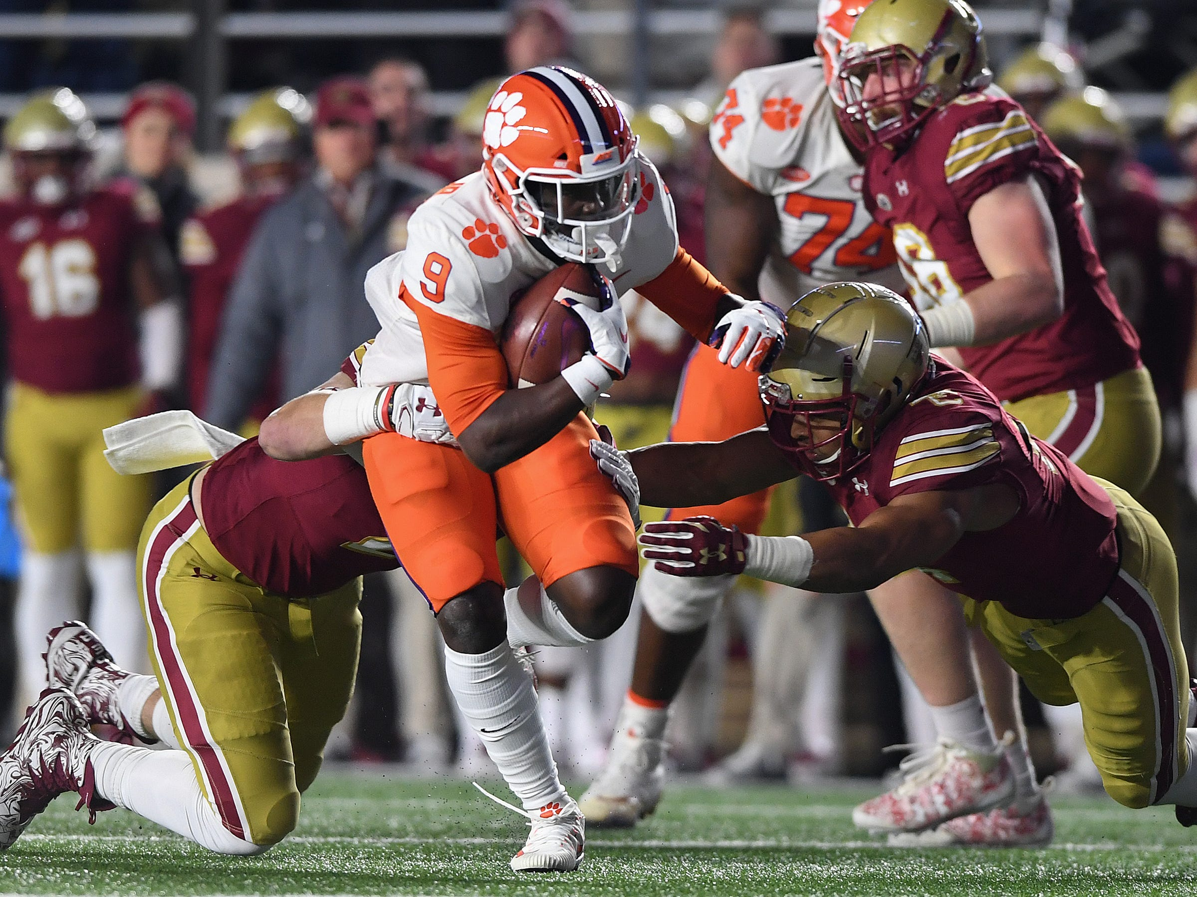 Clemson running back Travis Etienne (9) carries against Boston College during the 1st quarter at Boston College's Alumni Stadium in Chestnut Hill, MA. Saturday, November 10, 2018.