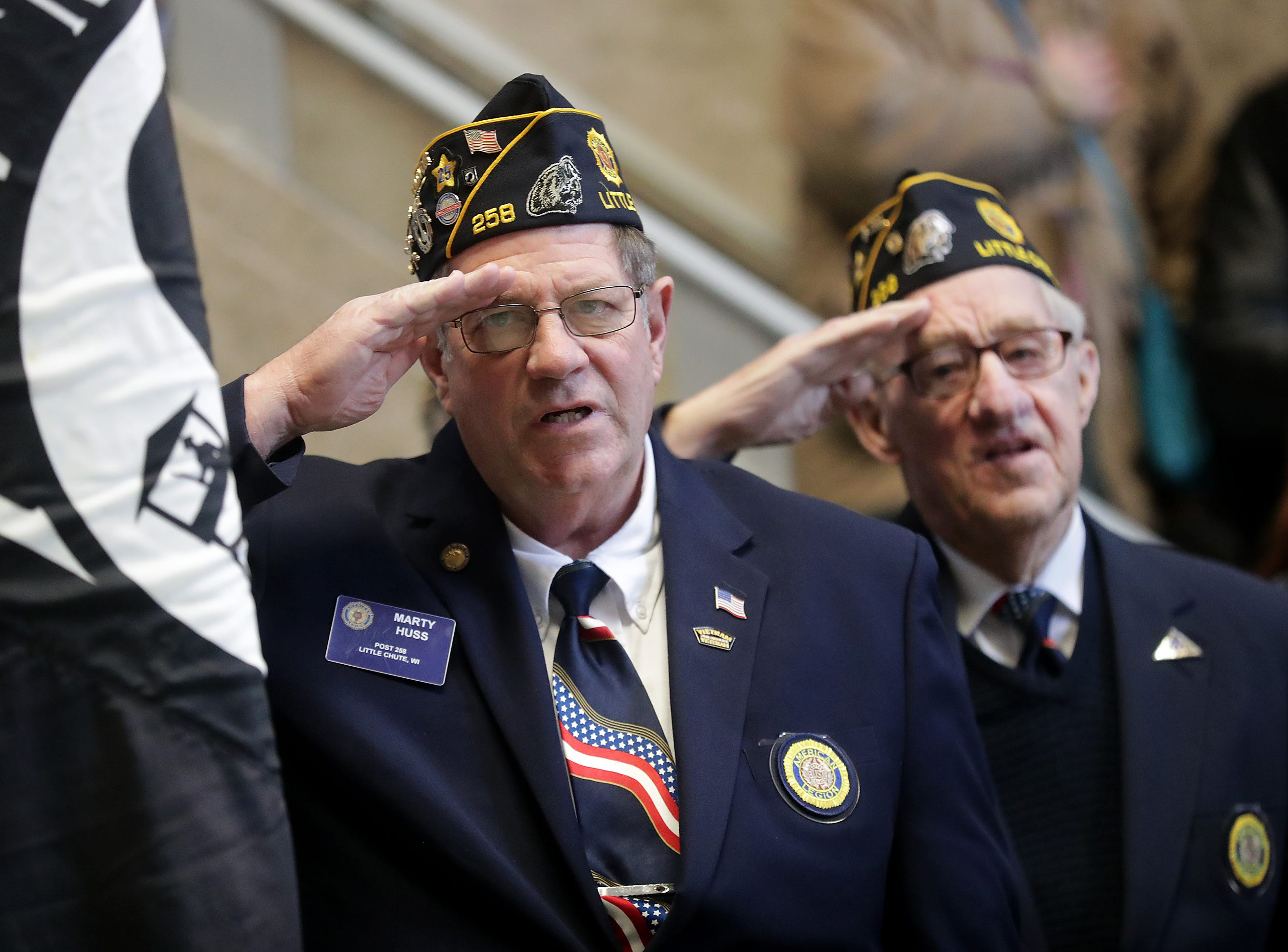 Marty Huss, Commander for American Legion Little Chute Post 258, and Leroy Va Asten, Post 258, salute during the Outagamie County Veterans Day Service on Sunday, Nov. 11, 2018, in Appleton, Wis. The service, in part, commemorated the 100th anniversary of the end of WW I.