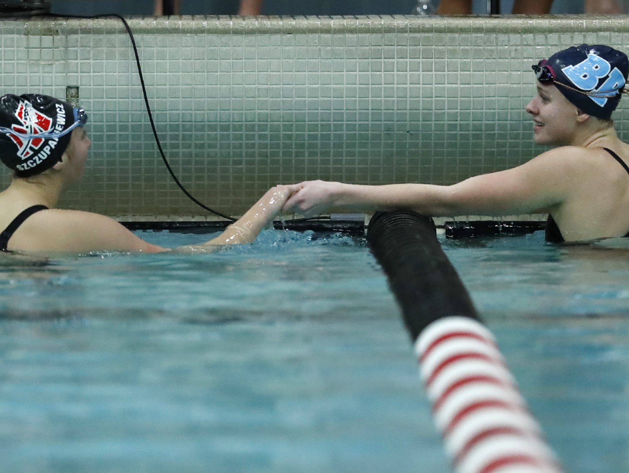 Muskego's Erin Szczupakiewicz shakes hands with Bay PortÕs Emma Lasecki after the 100 yard butterfly during the WIAA Division 1 State Swimming and Diving meet Saturday, Nov. 10, 2018, at the UW Natatorium in Madison, Wis. Danny Damiani/USA TODAY NETWORK-Wisconsin