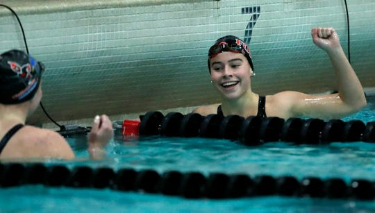 Fond du Lac's Isabella Jones reacts after finishing the 200-yard freestyle during the WIAA Division 1 state swimming and diving meet at the UW Natatorium in Madison.