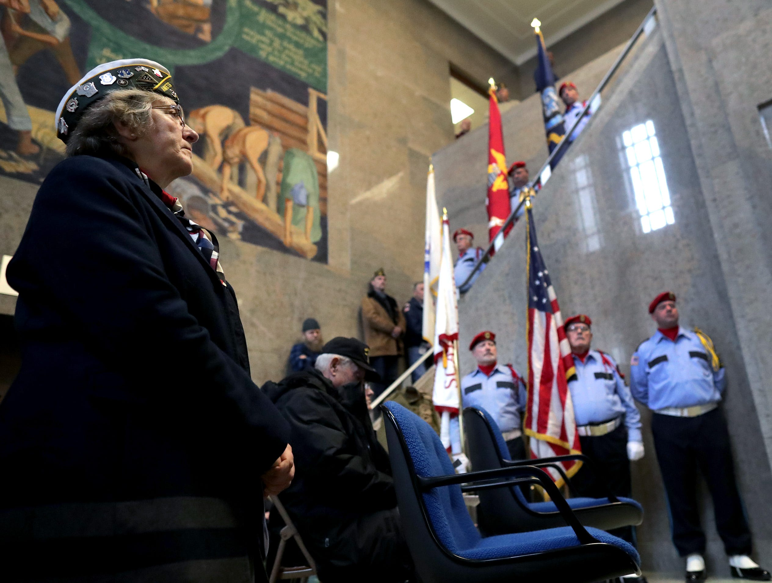 Kim Kraddock, Air Force, listens during the Outagamie County Veterans Day Service on Sunday, Nov. 11, 2018, in Appleton, Wis. The service, in part, commemorated the 100th anniversary of the end of WW I.