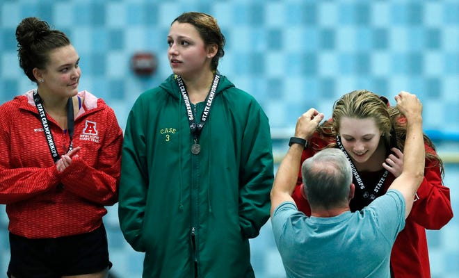 Neenah's Av Osero gets her first place medal after winning the Division 1 diving at the WIAA State Swimming and Diving meet Saturday at the UW Natatorium in Madison.