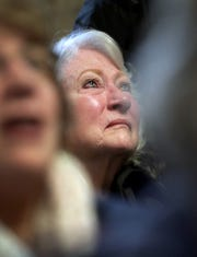 "Marie Hughes listens to ""God Bless America"" during the Outagamie County Veterans Day Service on Sunday in Appleton, Wis. The service, in part, commemorated the 100th anniversary of the end of World War I."