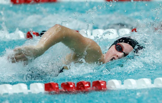 Neenah's Claire Eisele races in the 100- yard freestyle at the Division 1 state meet Saturday in Madison.