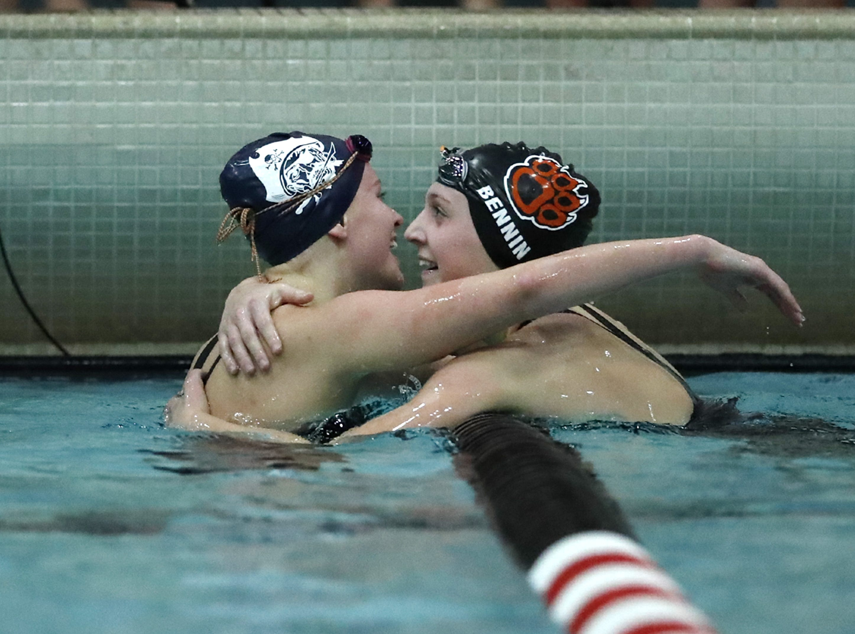 Bay PortÕs  Emma Lasecki hugs Verona Area's Grace Bennin after racing the 200 yard individual medley during the WIAA Division 1 State Swimming and Diving meet Saturday, Nov. 10, 2018, at the UW Natatorium in Madison, Wis. Danny Damiani/USA TODAY NETWORK-Wisconsin