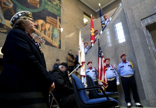 Kim Kraddock, Air Force, listens during the Outagamie County Veterans Day service on Sunday in Appleton. The service, in part, commemorated the 100th anniversary of the end of WWI.