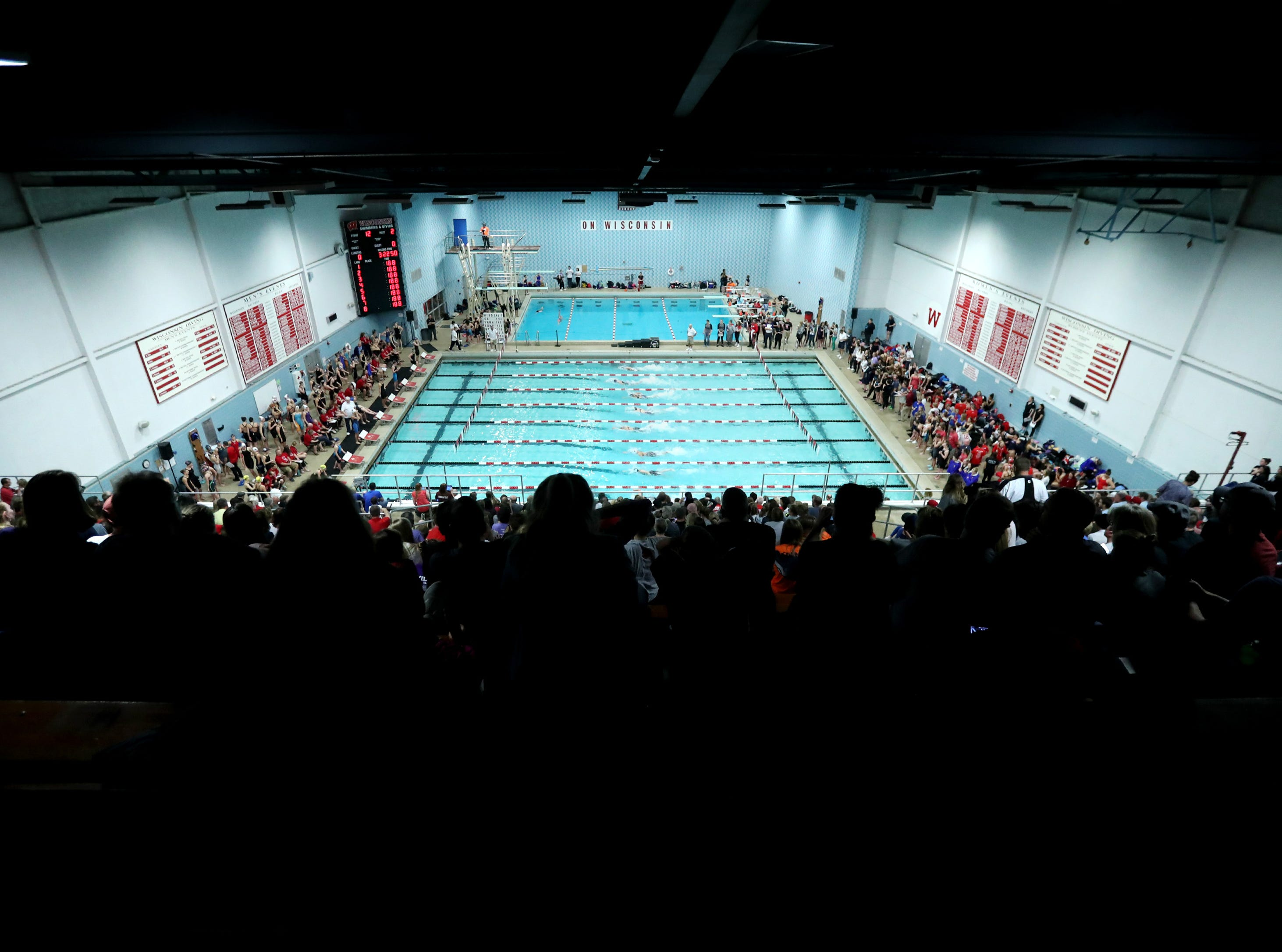 The crowd watches as racers compete in the 400 yard freestyle relay during the WIAA Division 1 State Swimming and Diving meet Saturday, Nov. 10, 2018, at the UW Natatorium in Madison, Wis. Danny Damiani/USA TODAY NETWORK-Wisconsin