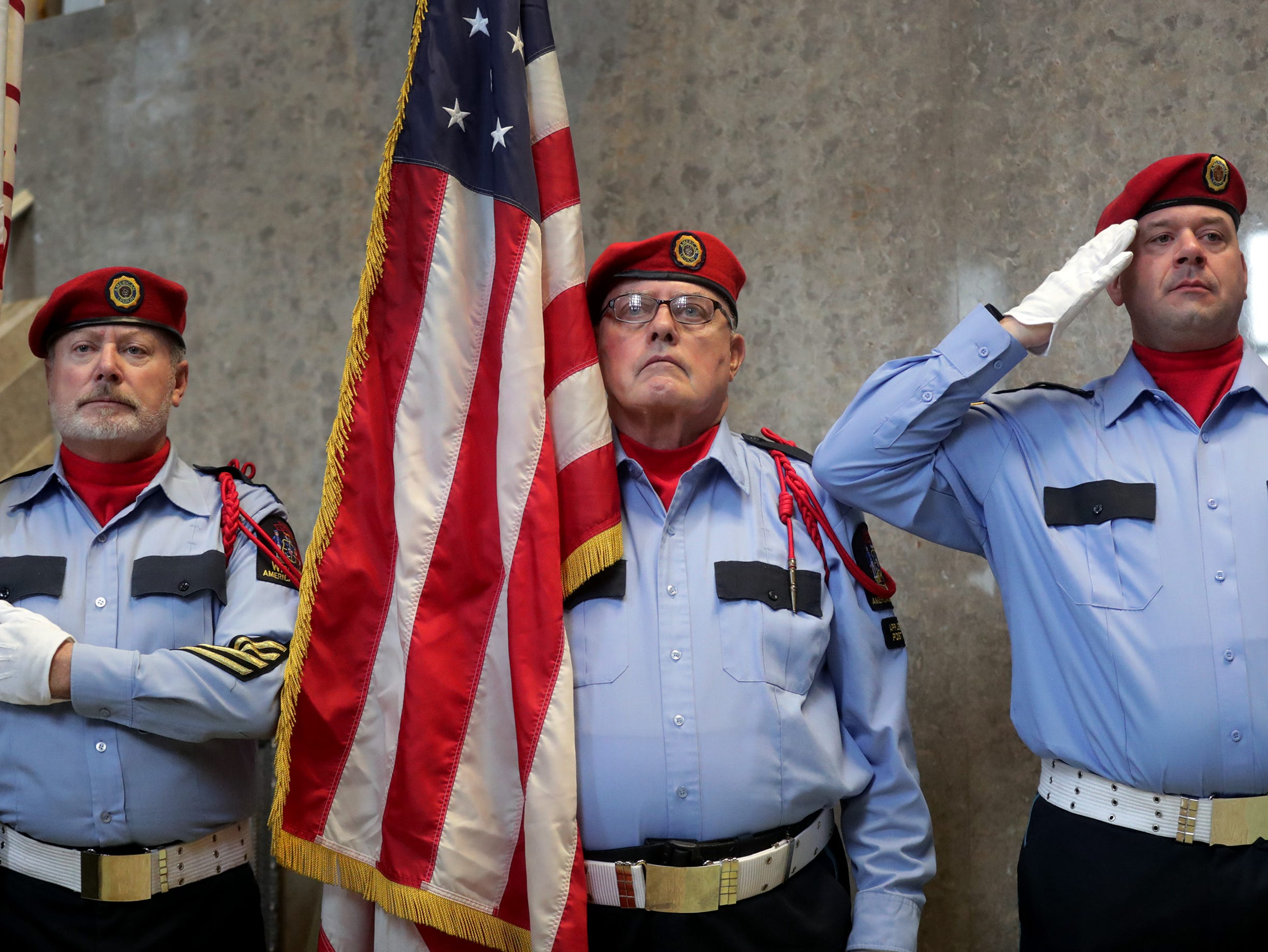 Appleton American Legion Post 38 Scarlet Guard members stand during the Outagamie County Veterans Day Service on Sunday, Nov. 11, 2018, in Appleton, Wis. The service, in part, commemorated the 100th anniversary of the end of WW I.