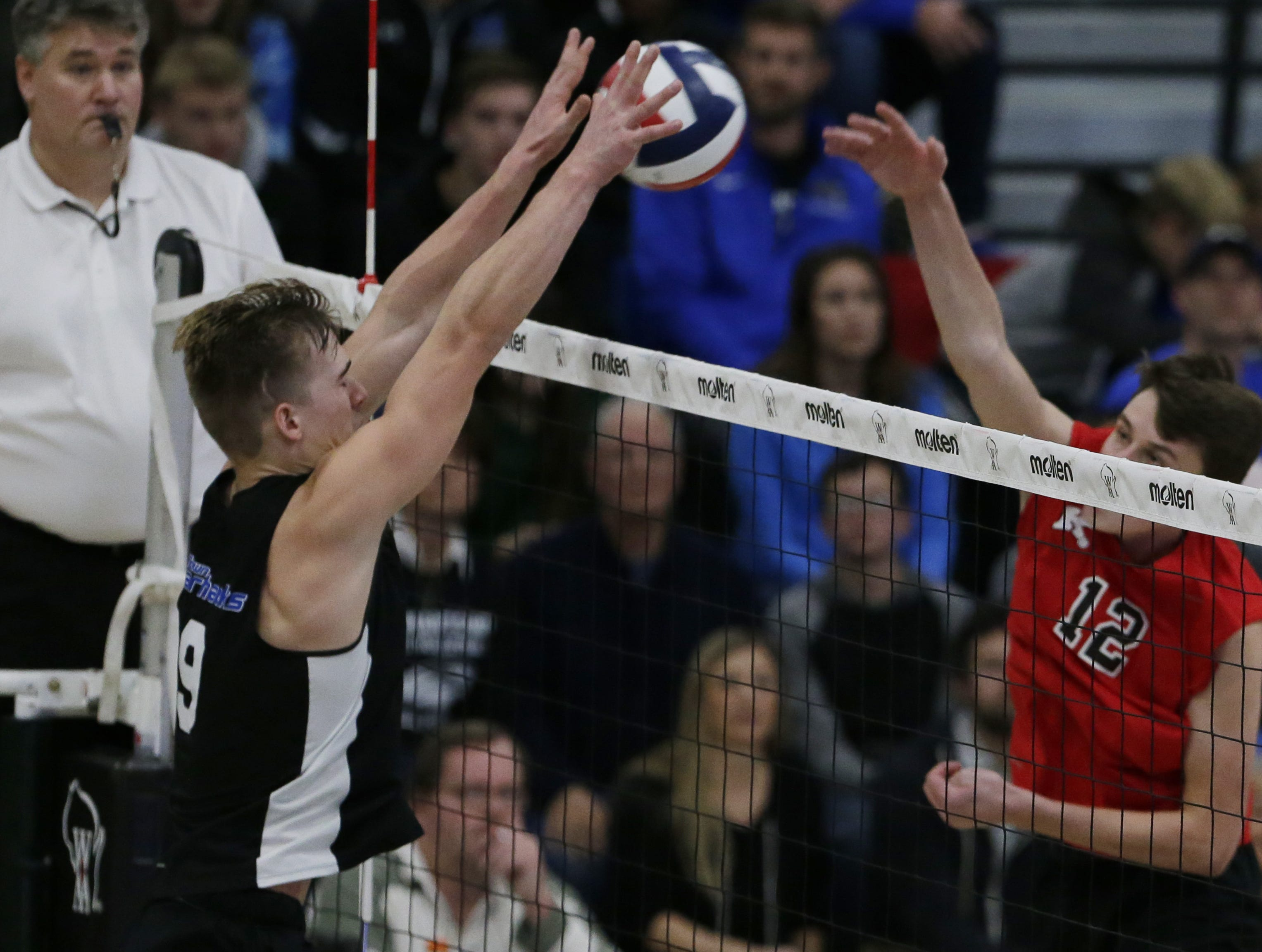 Kimberly's Parker Hietpas spikes the ball as Germantown's Bryce Behrendt blocks the hit.  Kimberly Papermakers played Germantown Warhawks in Division 1 WIAA State Boys Volleyball Championship, Saturday, November 10, 2018 at Wisconsin Lutheran College in Milwaukee, Wis. Joe Sienkiewicz/USA Today NETWORK-Wisconsin