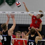 Kimberly's Tommy Clausz puts down a spike against Germantown during Saturday's state championship match.