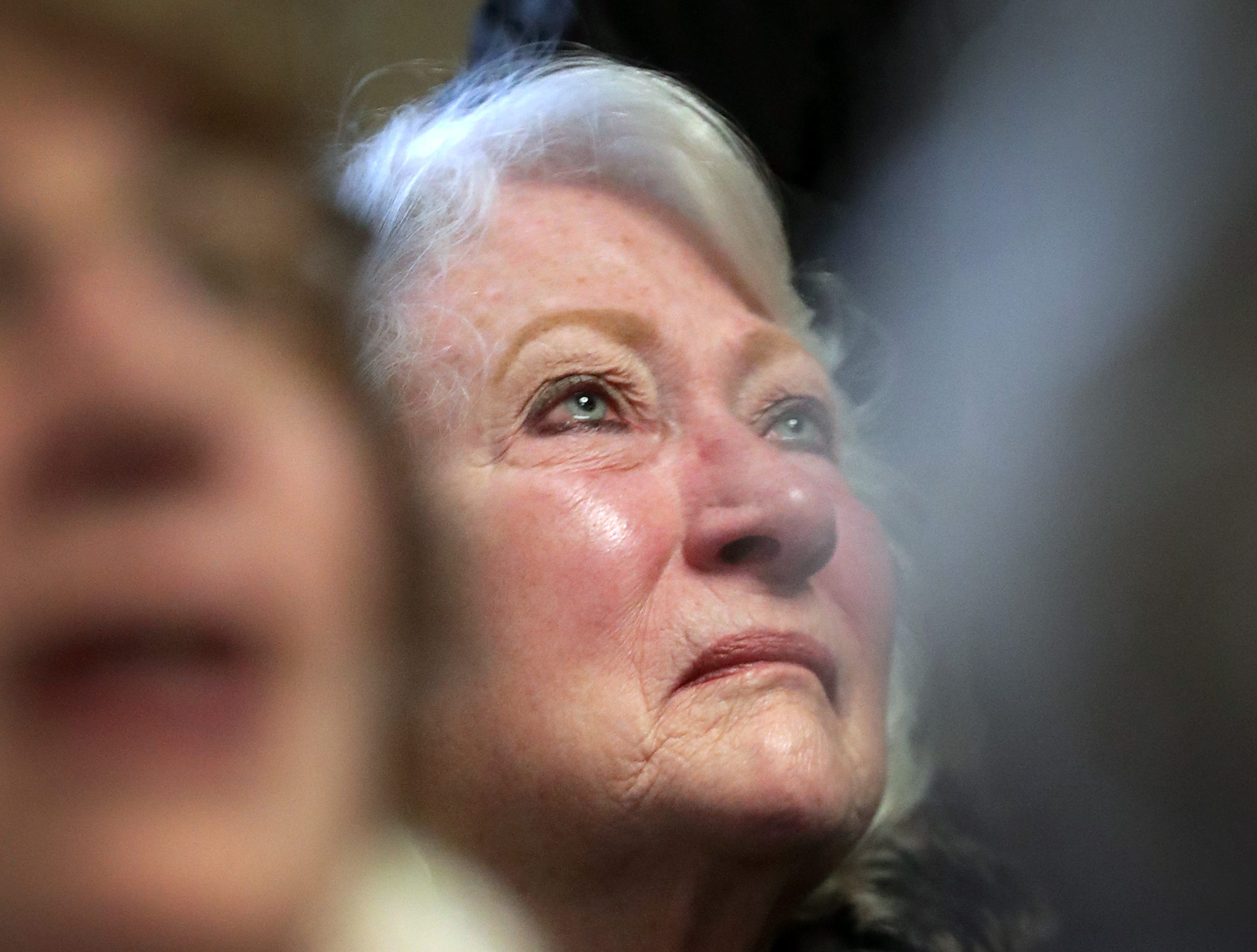 "Marie Hughes listens to ""God Bless America"" during the Outagamie County Veterans Day Service on Sunday, Nov. 11, 2018, in Appleton, Wis. The service, in part, commemorated the 100th anniversary of the end of WW I."
