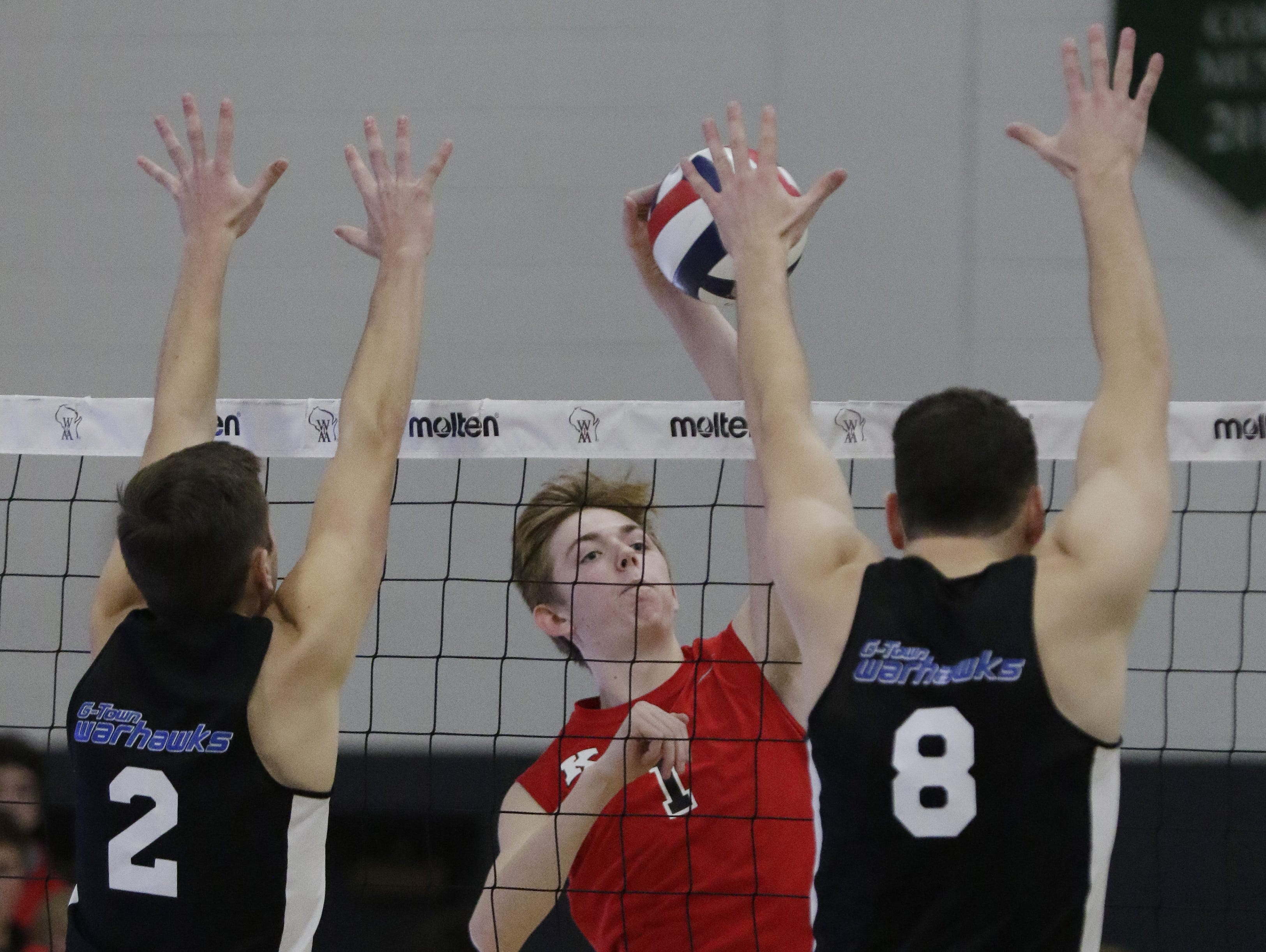 KimberlyÕs Spencer Herman spikes the ball against GermantownÕs Luke Taylor and Ben Schultz.  Kimberly Papermakers played Germantown Warhawks in Division 1 WIAA State Boys Volleyball Championship, Saturday, November 10, 2018 at Wisconsin Lutheran College in Milwaukee, Wis.  Kimberly took second place in the tournament.   Joe Sienkiewicz/USA Today NETWORK-Wisconsin