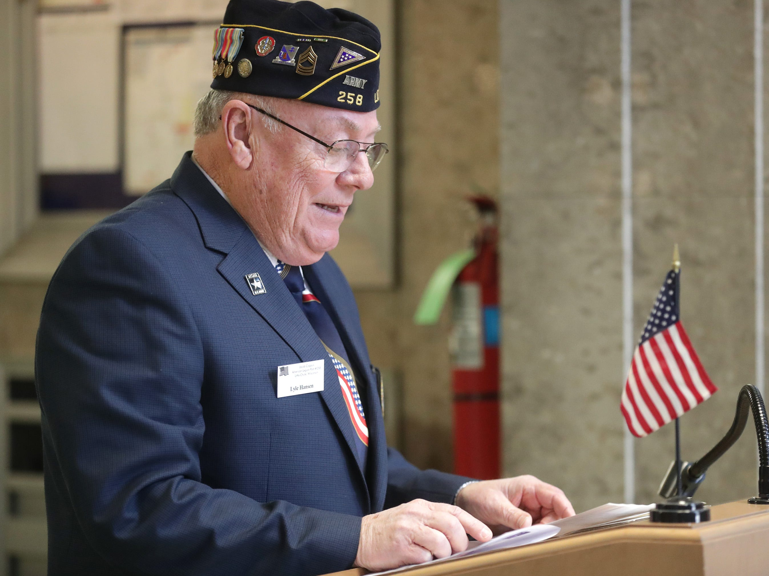 Keynote speaker Master Sgt. Lyle Hansen talks during the Outagamie County Veterans Day Service on Sunday, Nov. 11, 2018, in Appleton, Wis. The service, in part, commemorated the 100th anniversary of the end of WW I.