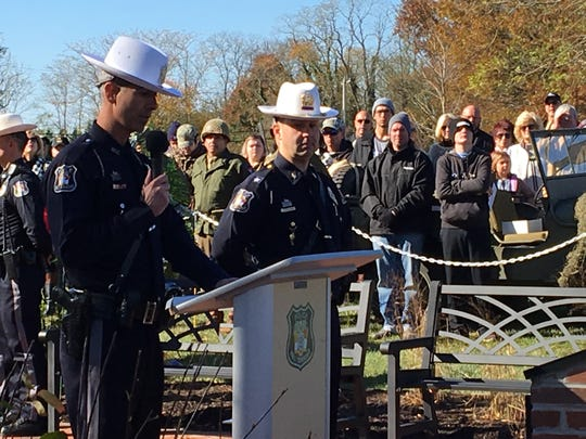 Wall Township police officer Mike Malone, left, and Wall police chief Kenneth Brown address the crowd at the dedication.